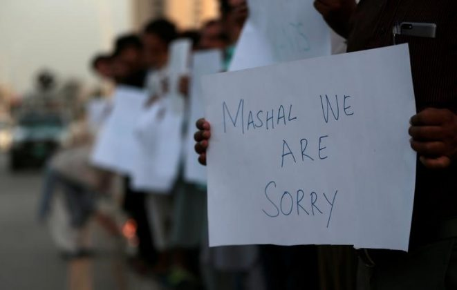 Protesters hold placards condemning the killing of university student Mashal Khan, after he was accused of blasphemy, during a protest in Islamabad, Pakistan April 18, 2017