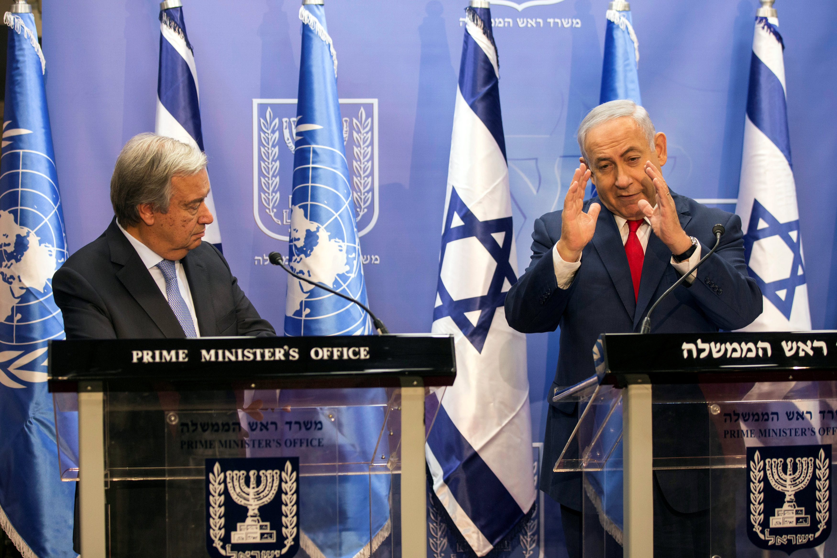 Israeli Prime Minister Benjamin Netanyahu (R) gestures as he delivers a joint statement with U.N. Secretary General Antonio Guterres in Jerusalem August 28,