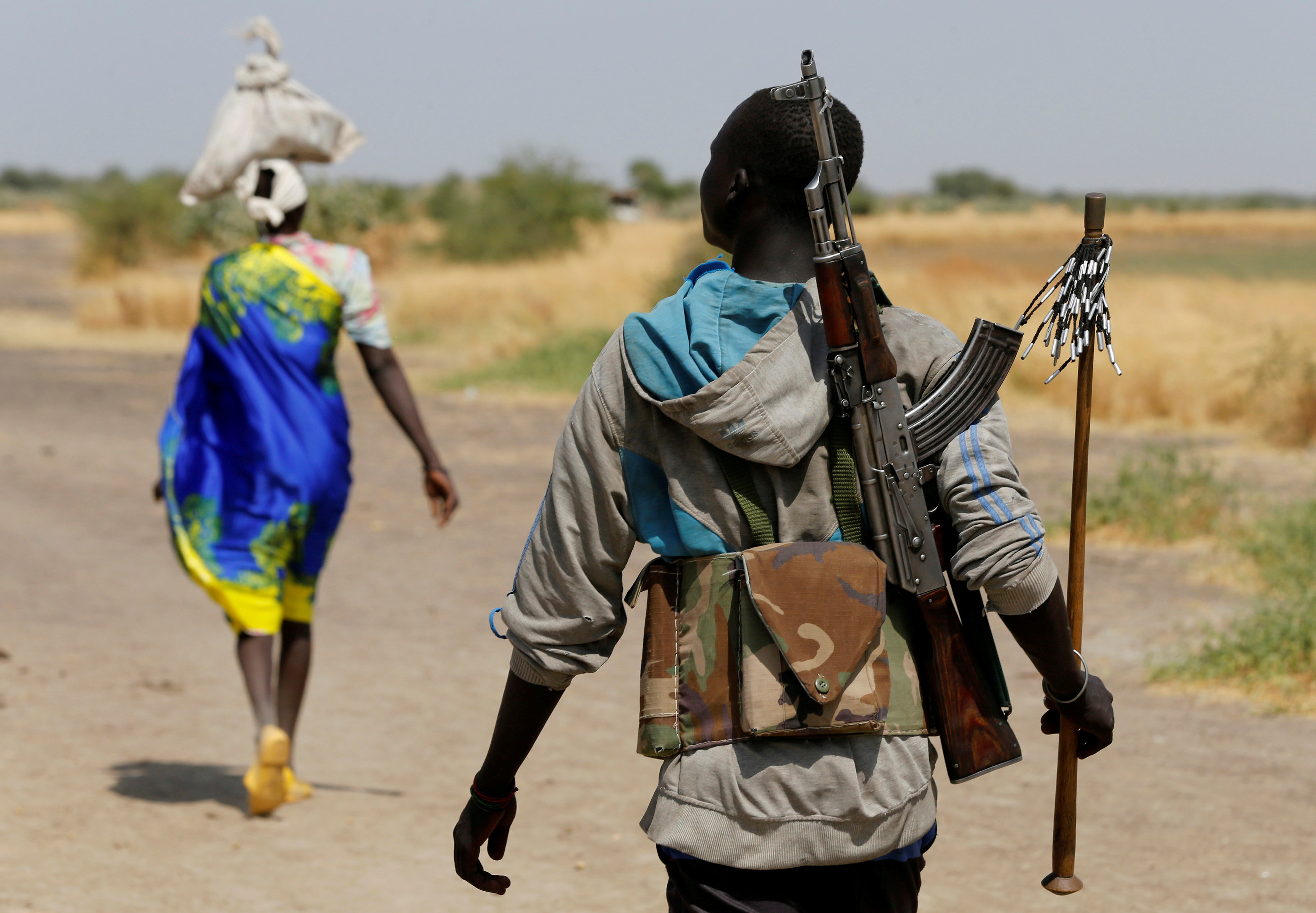 FILE PHOTO: An armed man walks on a path close to the village of Nialdhiu, South Sudan February 7, 2017. REUTERS/Siegfried Modola/File Photo