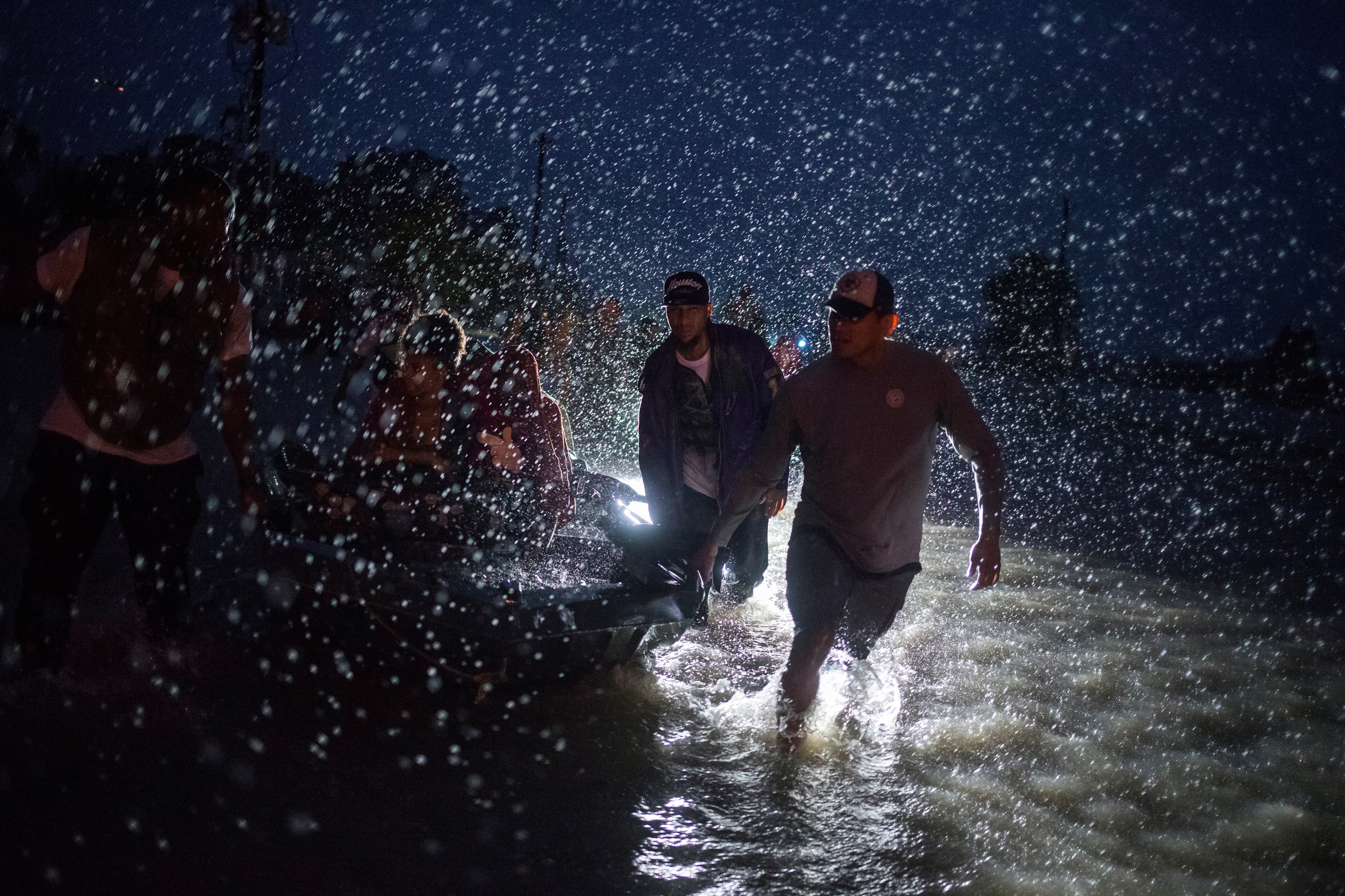 Dramatic nighttime rescues in flooded Houston suburbs as Harvey rolls on