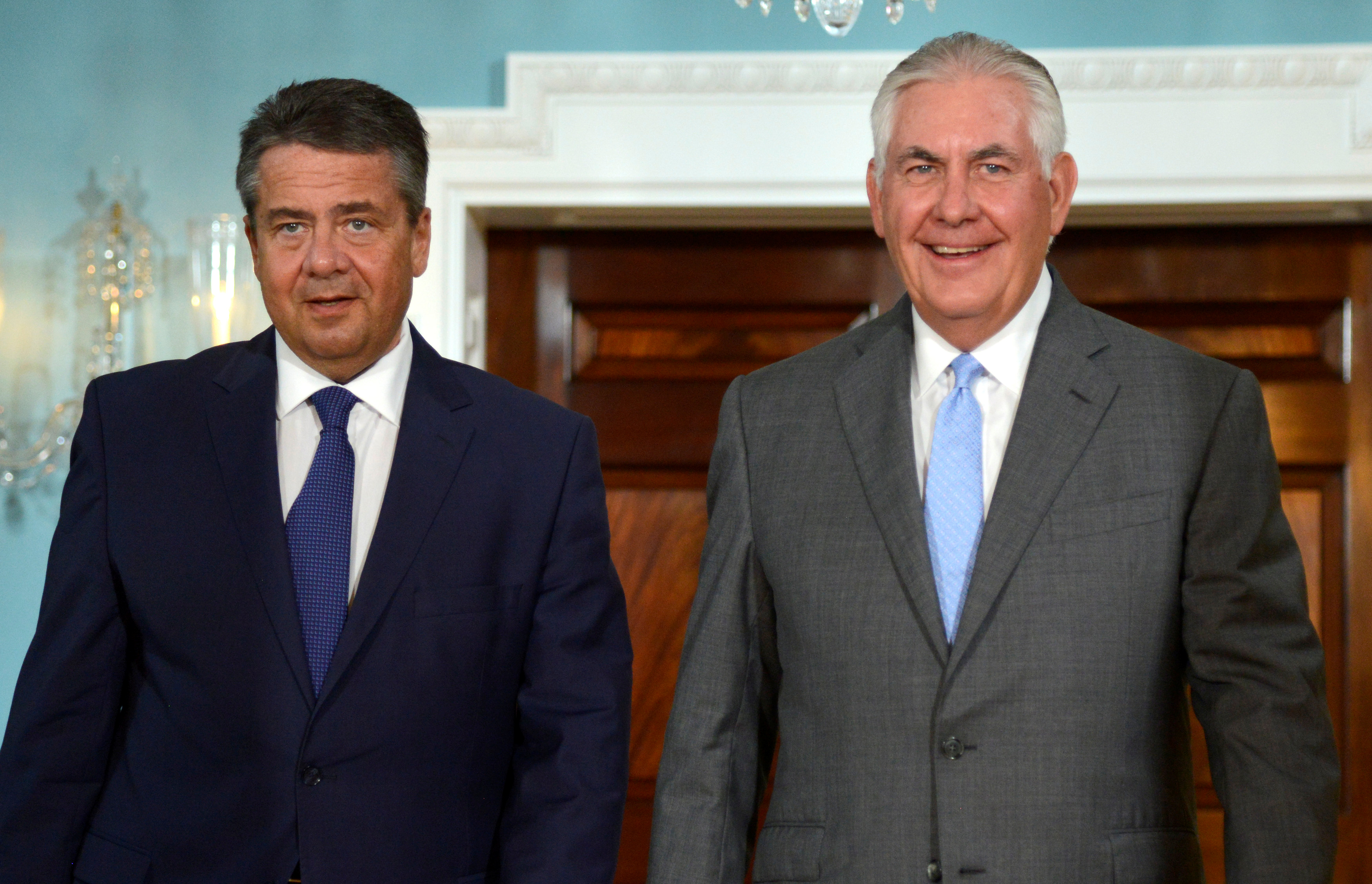 U.S. Secretary of State Rex Tillerson (R) and German Foreign Minister Sigmar Gabriel walk out to meet the press where Tillerson made a statement about the flooding in Houston, Texas, but declined questions, prior to a bilateral meeting, at the State Department, in Washington, U.S., August 29, 2017. REUTERS/Mike Theiler