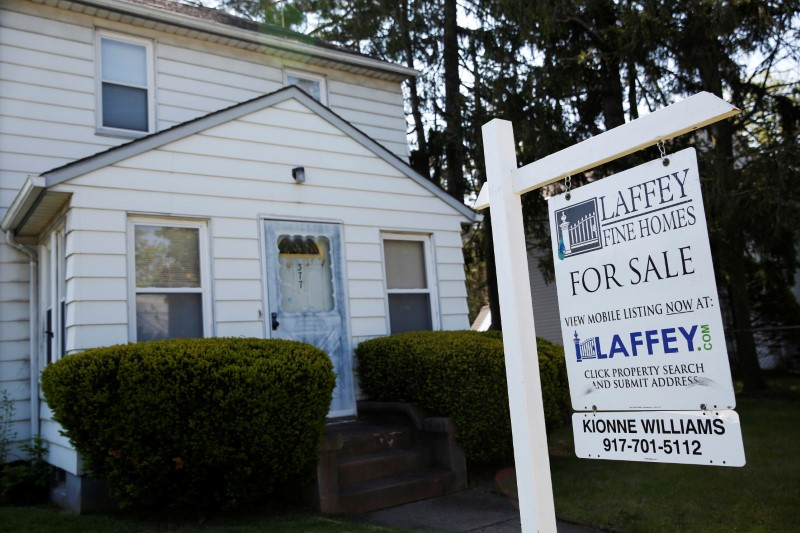 A 'for sale' is seen outside a single family house in Garden City, New York, U.S., May 23, 2016. REUTERS/Shannon Stapleton/File Photo