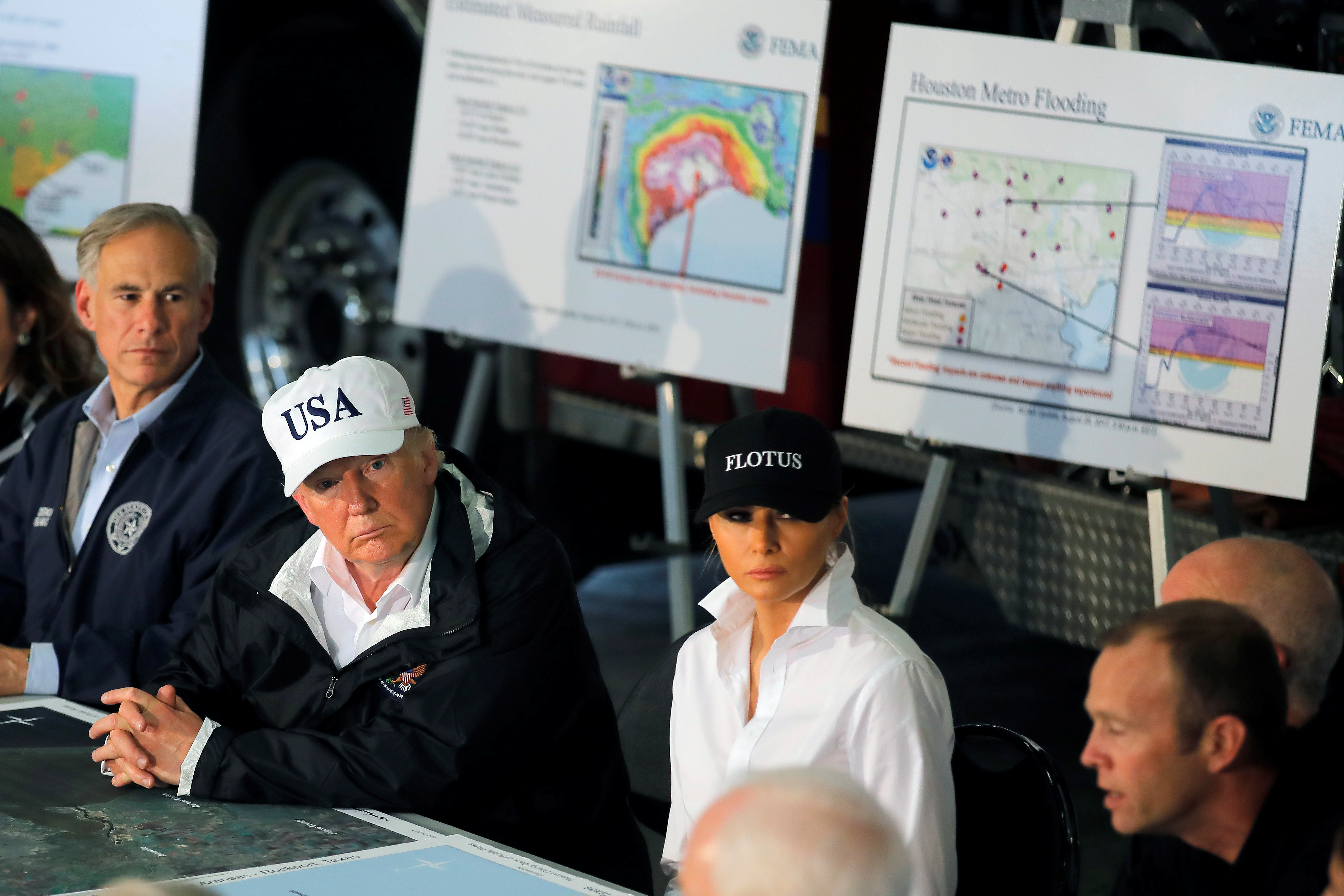 President Donald Trump and first lady Melania Trump receive a briefing on Tropical Storm Harvey relief efforts in Corpus Christi, Texas. REUTERS/Carlos Barria