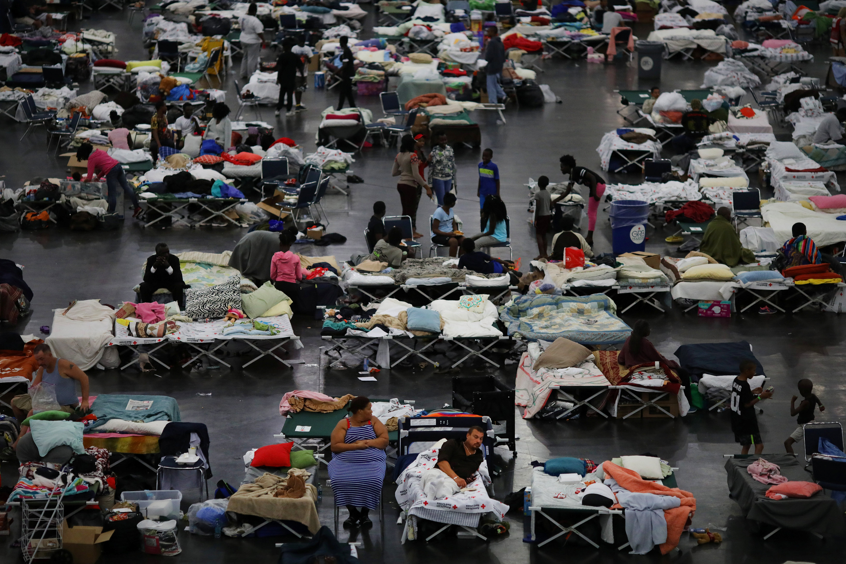 Evacuees affected by Tropical Storm Harvey take shelter at the George R. Brown Convention Center in downtown Houston, Texas, U.S.  August 31, 2017
