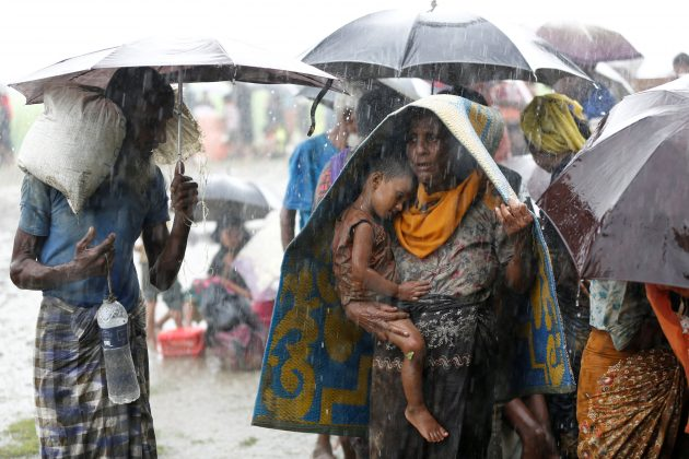 Rohingya refugees stands in an open place during heavy rain, as they are hold by Border Guard Bangladesh (BGB) after illegally crossing the border, in Teknaf, Bangladesh, August 31, 2017.