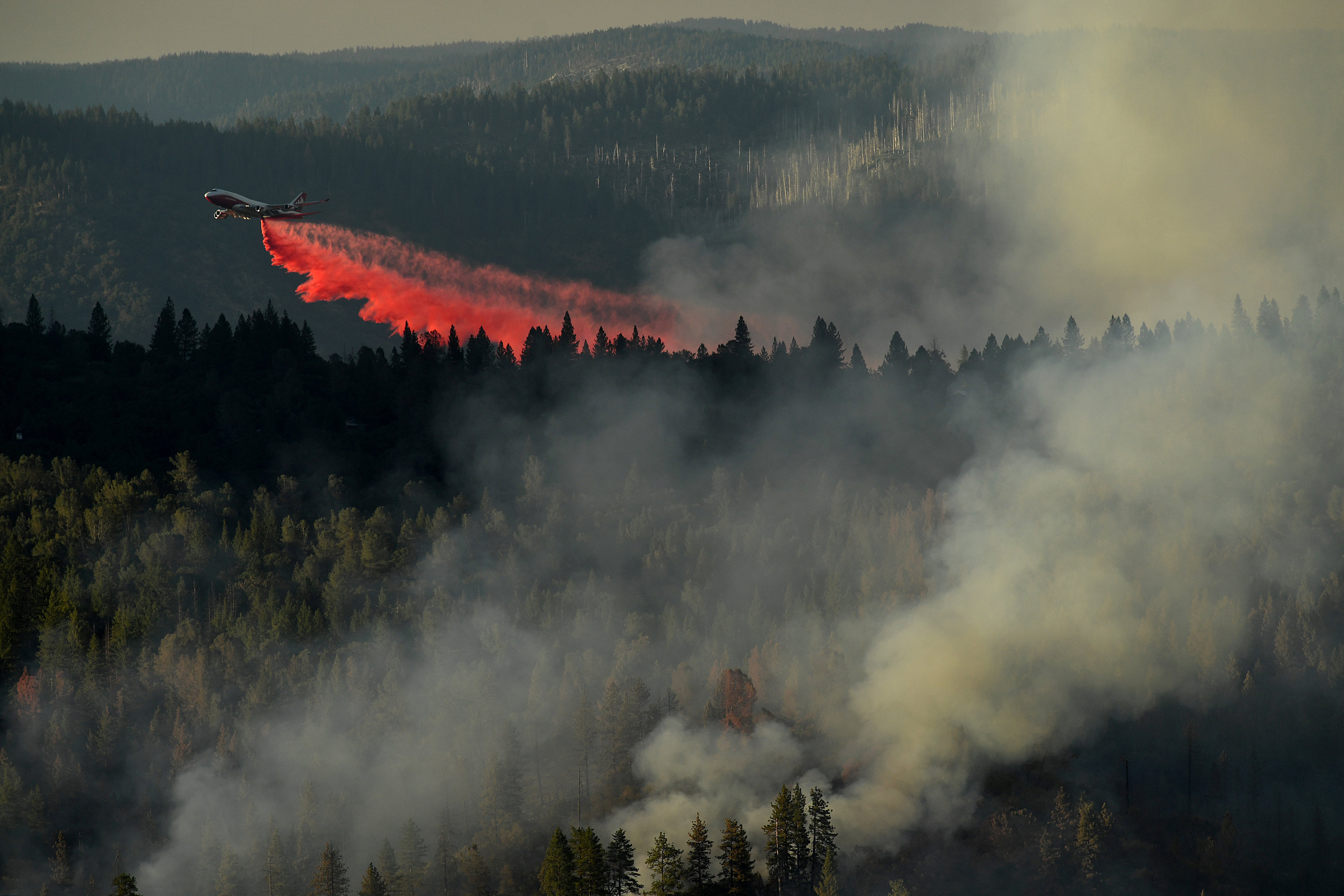 A 747 SuperTanker drops retardant while battling the Ponderosa Fire east of Oroville, California, U.S. August 30, 2017.