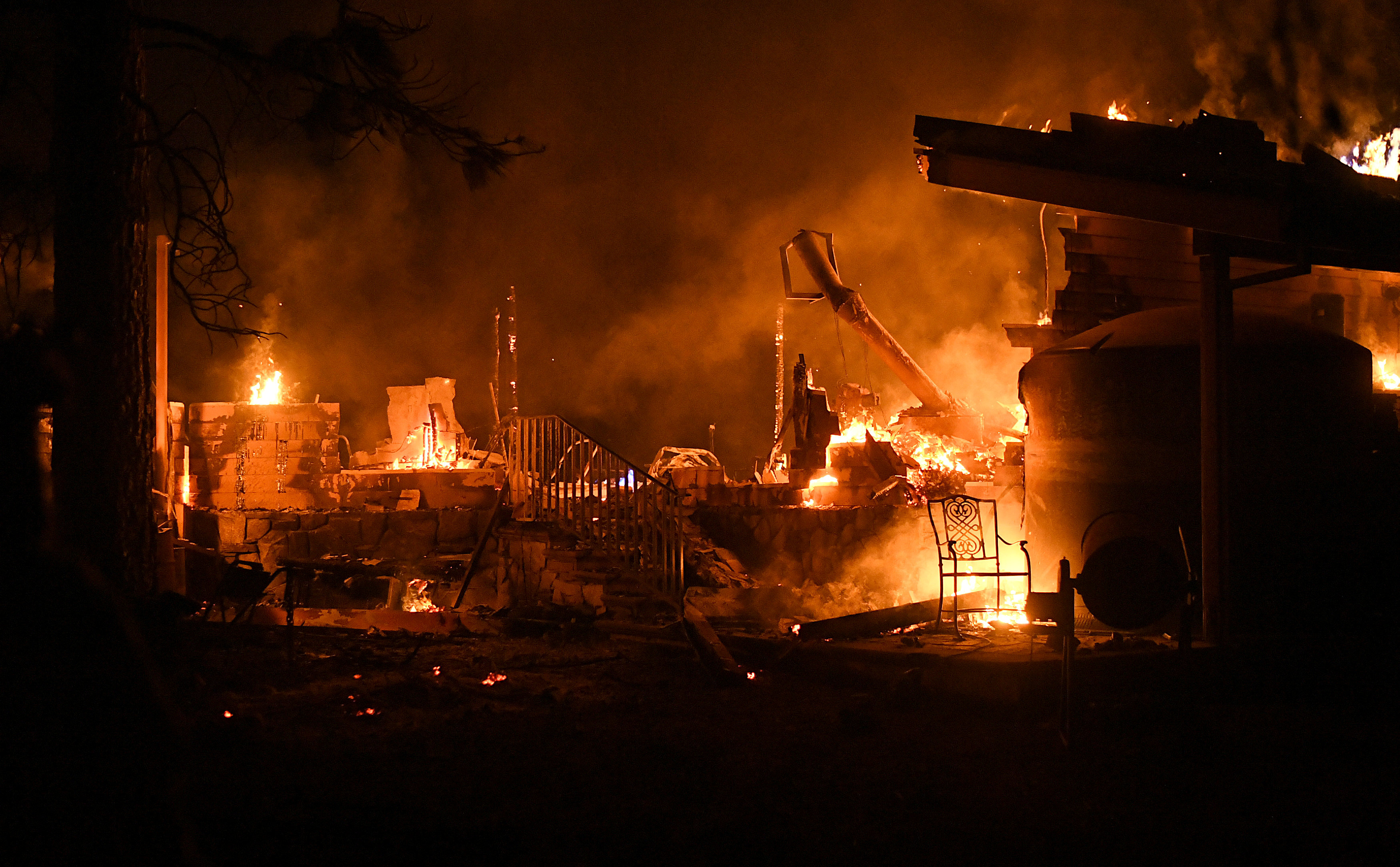 Flames consume a garage as the Ponderosa Fire burns east of Oroville, California, U.S. August 29, 2017.
