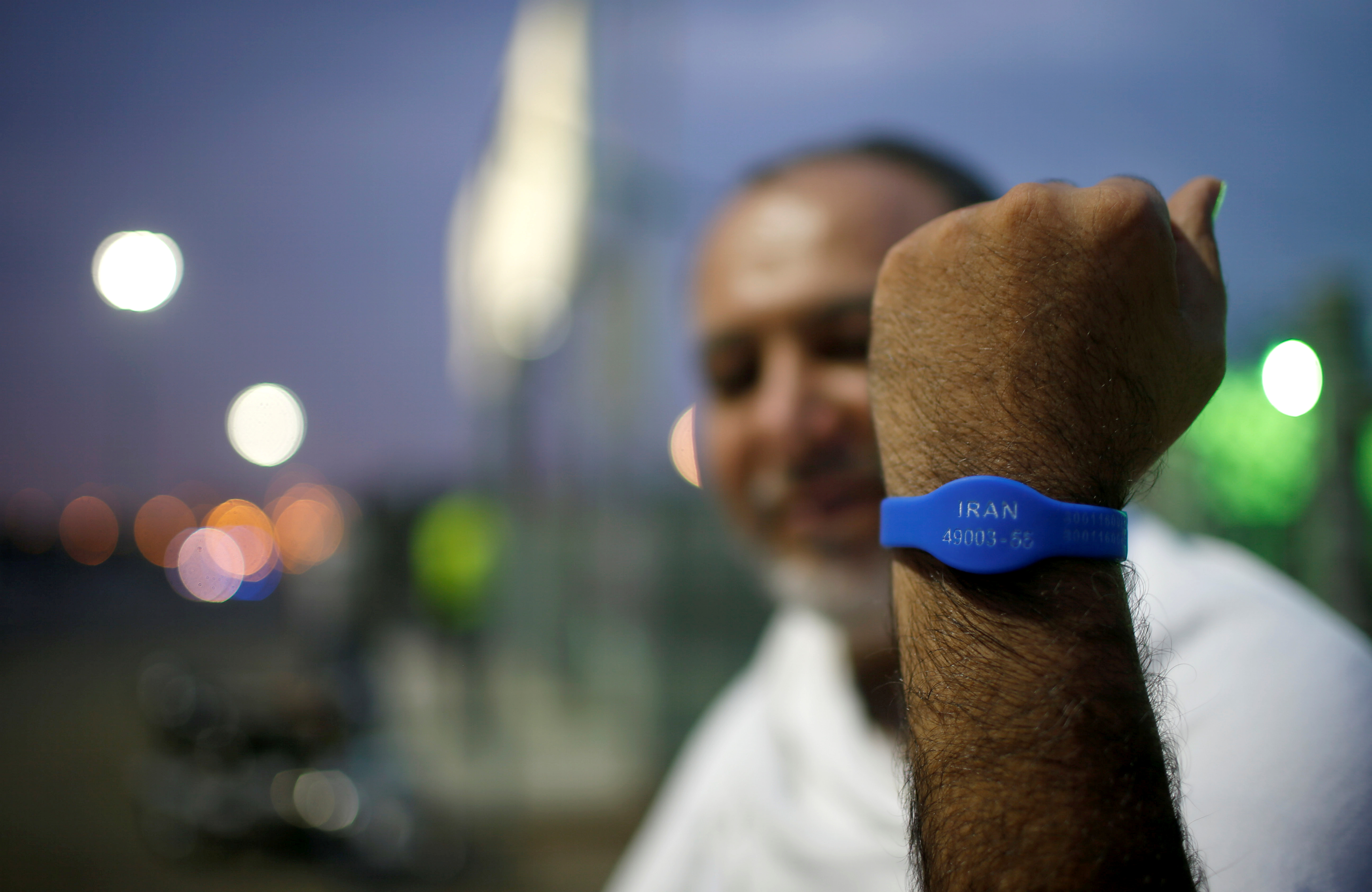 An Iranian pilgrim shows bracelet on his hand during the annual haj pilgrimage, in Arafat outside the holy city of Mecca, Saudi Arabia August 30,