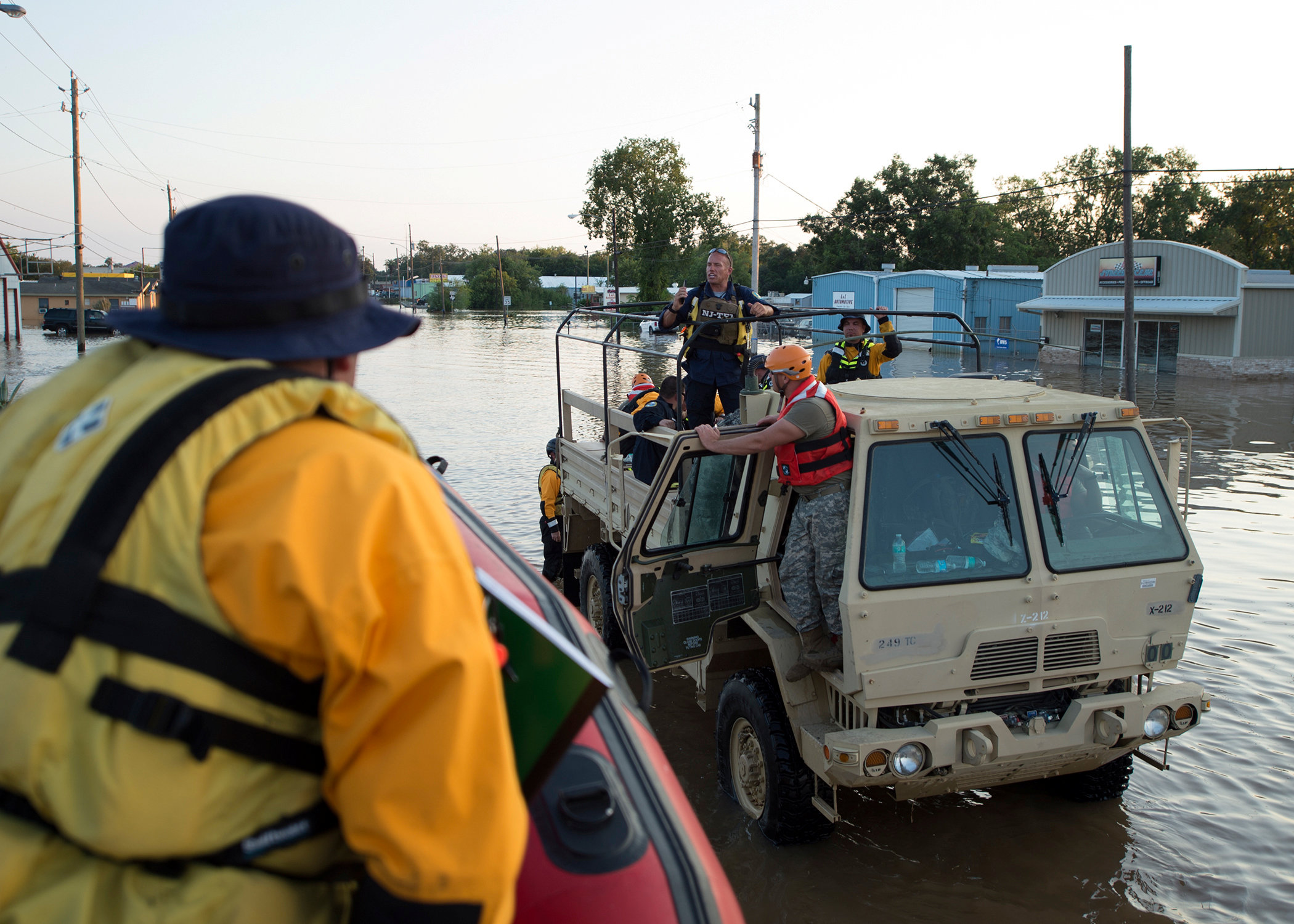 Members of Army National Guard conduct high water rescue operations in the aftermath of Tropical Storm Harvey in Wharton, Texas, U.S. in this August 31, 2017 handout photo. Senior Master Sgt. Robert Shelley/Air National Guard/Handout via REUTERS