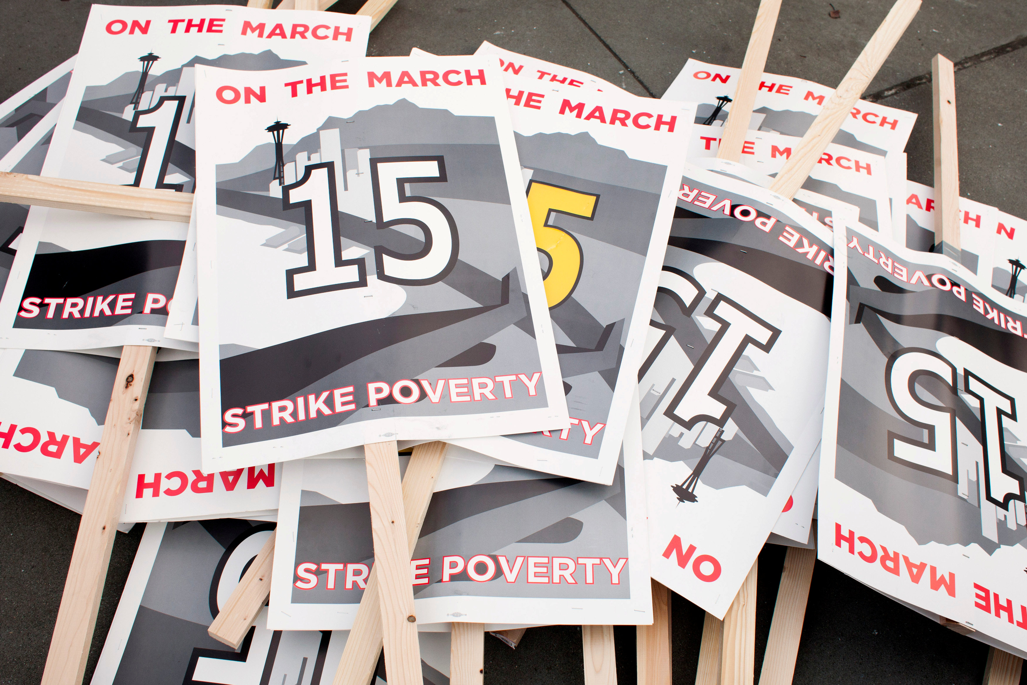 FILE PHOTO: Protest signs are pictured in SeaTac, Washington just before a march from SeaTac to Seattle aimed at the fast food industry and raising the federal minimum wage and Seattle's minimum wage to $15 an hour December 5, 2013. REUTERS/David Ryder/File Photo