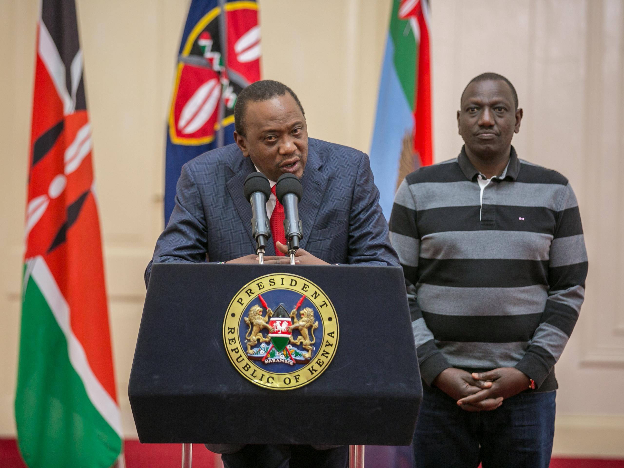 Kenya's President Uhuru Kenyatta flanked by his Deputy William Ruto addresses the nation at State House in Nairobi, Kenya September 1, 2017. Presidential Press Service/Handout via REUTERS