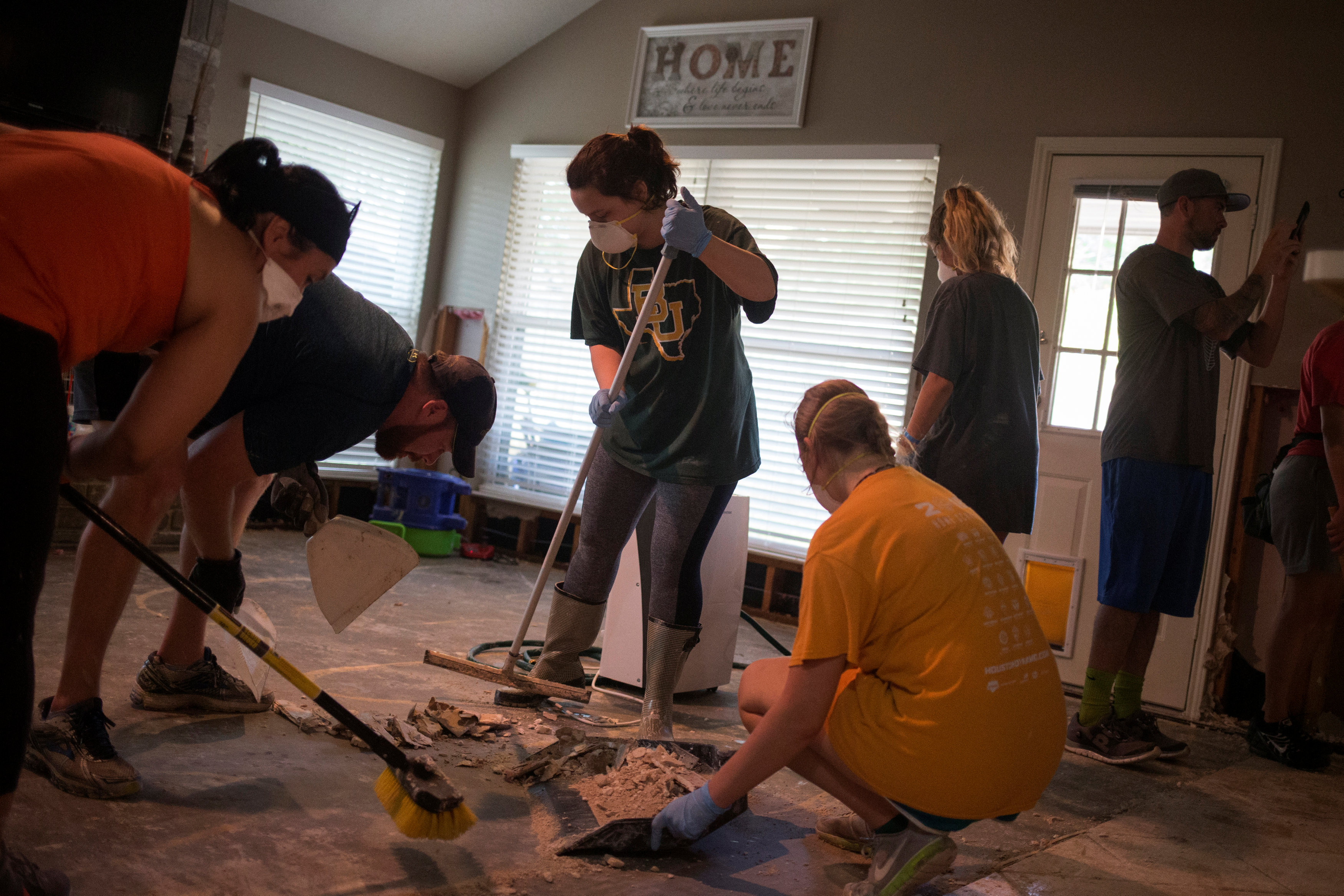 Samaritans help clear debris from the house of a neighbor which was left flooded from Tropical Storm Harvey in Houston, Texas, U.S. September 3, 2017.