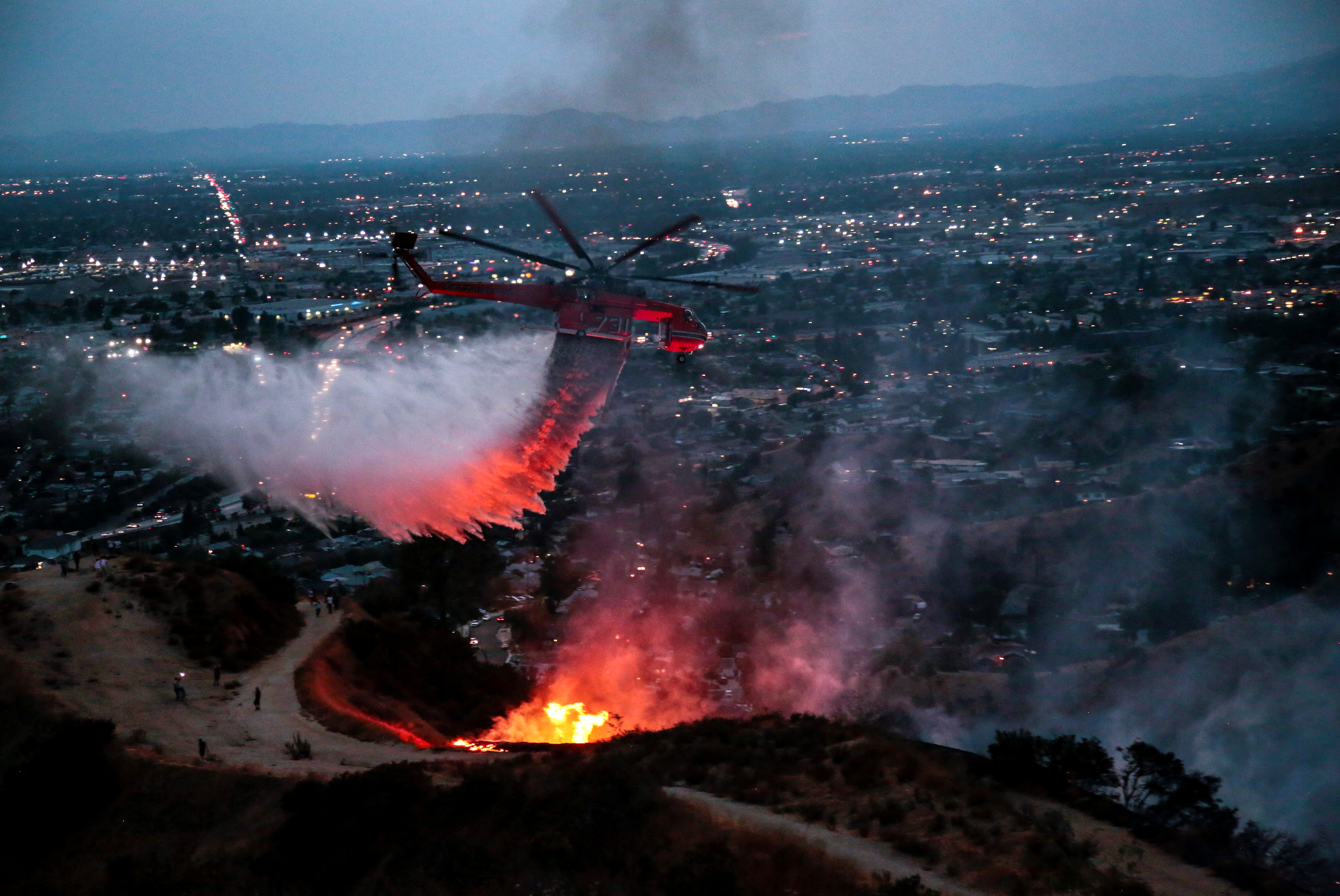 Water is dropped above homes in Sun Valley during the La Tuna Canyon fire over Burbank, California, U.S., September 2,