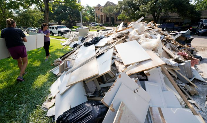 Church Volunteers work to remove Hurricane Harvey flood damage from a home in Houston, Texas, U.S. September 2, 2017.