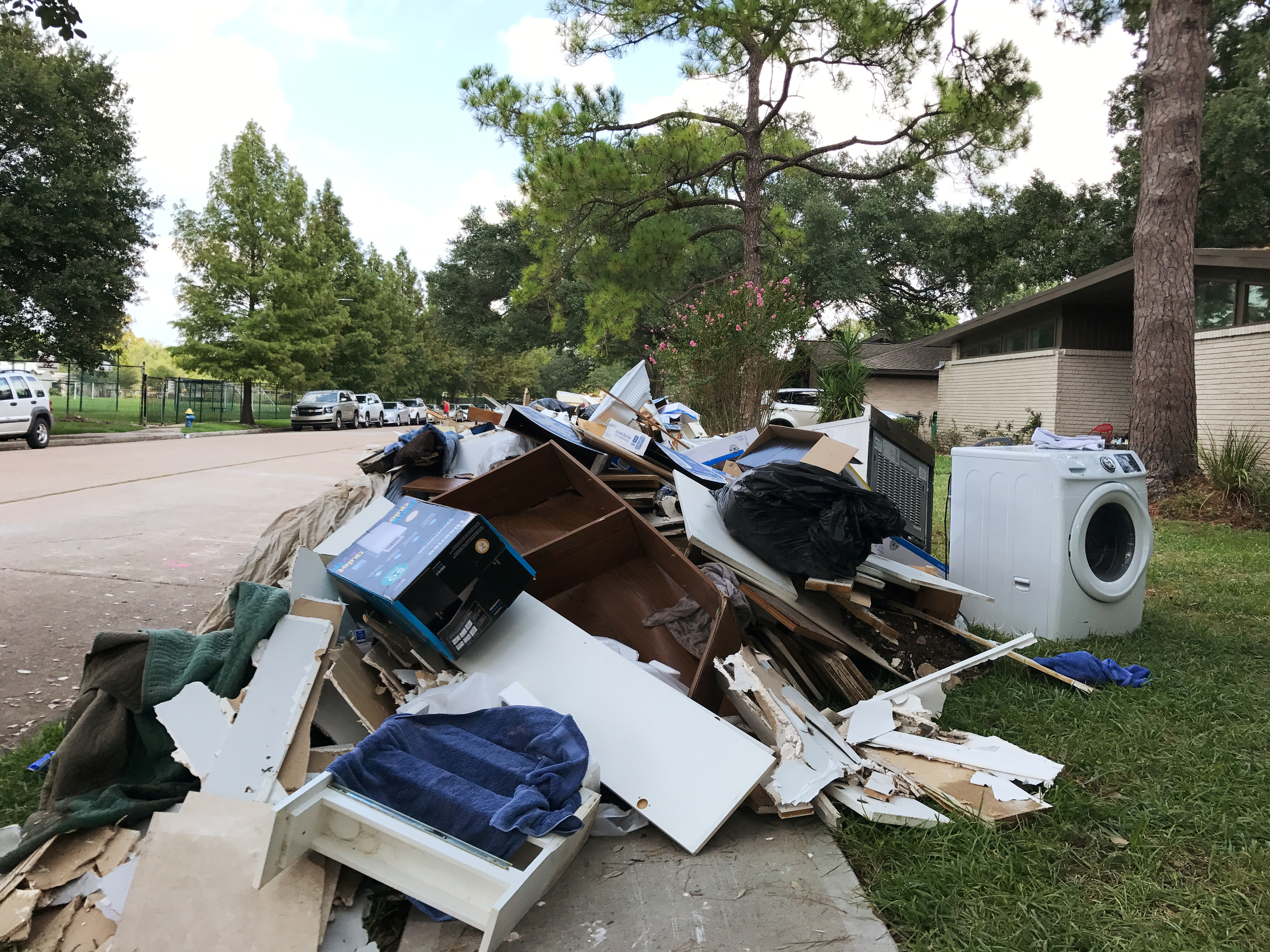 Rotting drywall and other material ripped out of homes damaged by Tropical Storm Harvey sits on the edge of a residential street in Houston's Meyerland neighborhood in Houston, Texas, U.S., September 4, 2017. REUTERS/Ernest ScheyderRotting drywall and other material ripped out of homes damaged by Tropical Storm Harvey sits on the edge of a residential street in Houston's Meyerland neighborhood in Houston, Texas, U.S., September 4, 2017. REUTERS/Ernest Scheyder