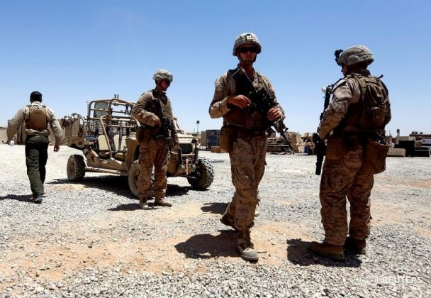 FILE PHOTO: U.S. Marines walk inside their base after they are back from training with Afghan National Army (ANA) soldiers in Helmand province, Afghanistan July 6, 2017. REUTERS/ Omar Sobhani