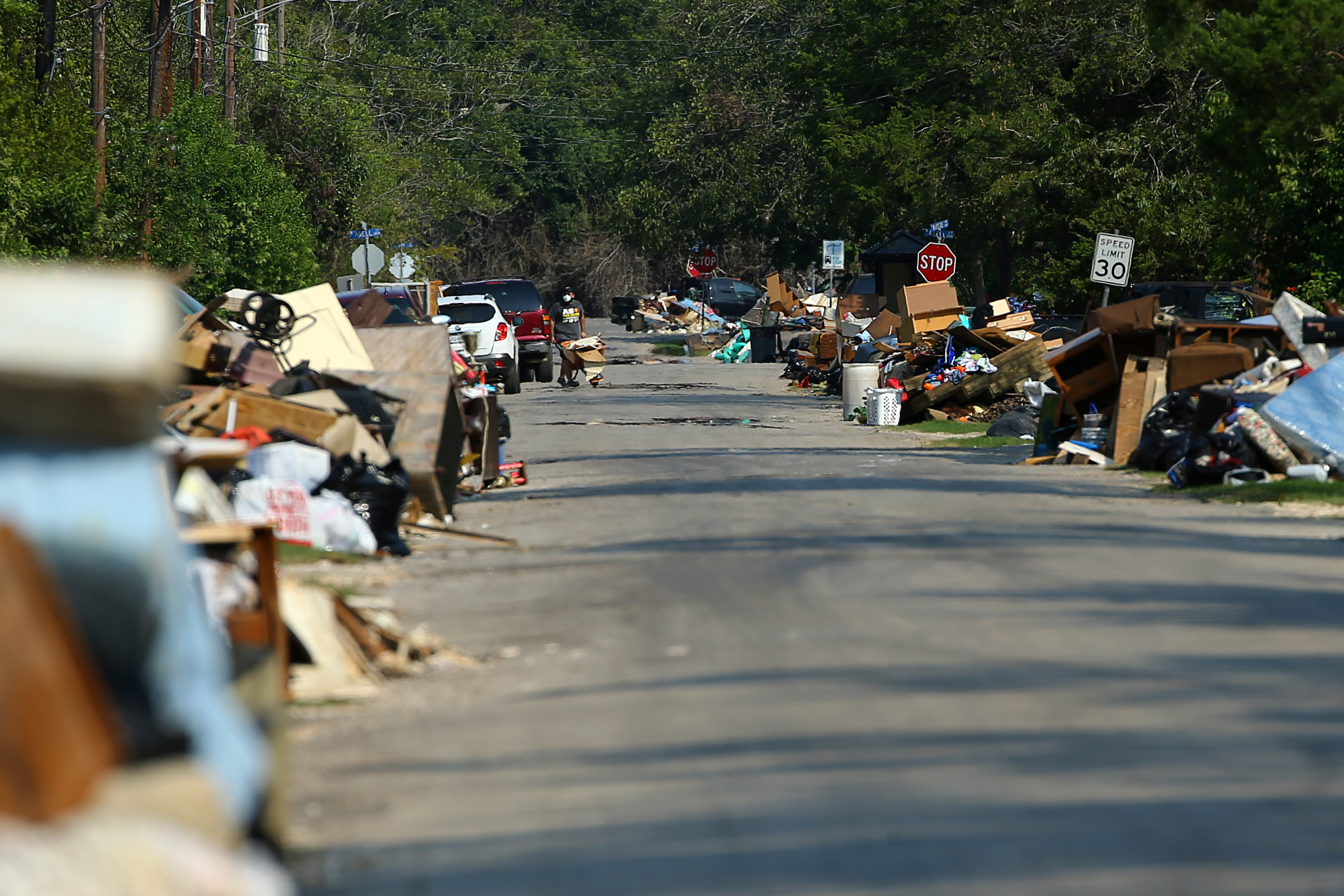 Flood-damaged contents from people's homes line the street following the aftermath of tropical storm Harvey in Wharton, Texas, U.S., September 6, 2017. REUTERS/Mike Blake