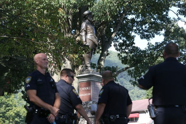 "Police officers stand around a statue of Confederate general Thomas J. ""Stonewall"" Jackson during a Black Lives Matter rally in Charleston, West Virginia, U.S., August 20, 2017. REUTERS/Marcus Constantino"
