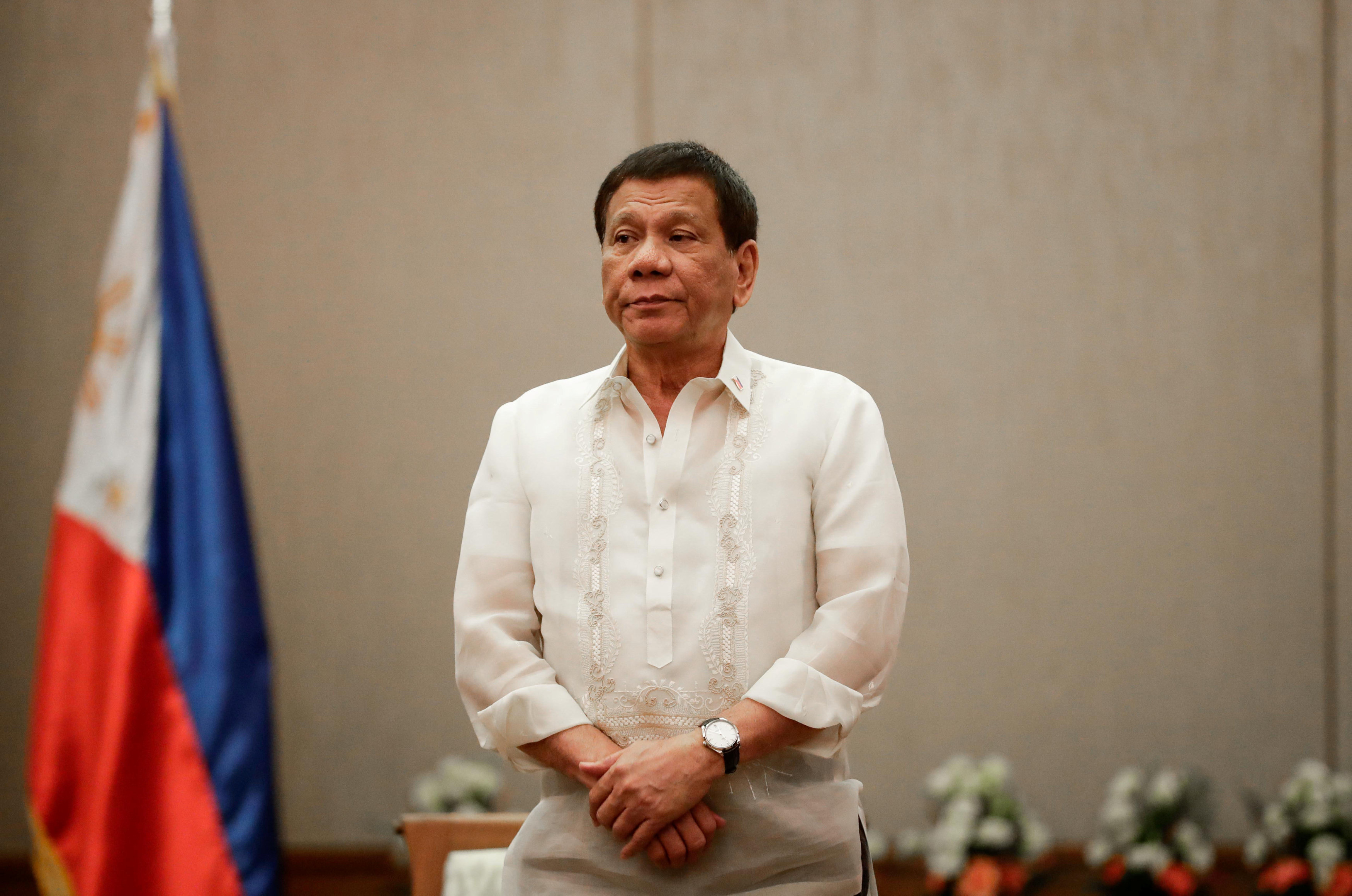 Philippines 'President Rodrigo Duterte stands at attention during a courtesy call with the Association of Southeast Asian Nations (ASEAN) Economic Ministers in Manila, Philippines, September 6, 2017. REUTERS/Pool/Mark Cristino