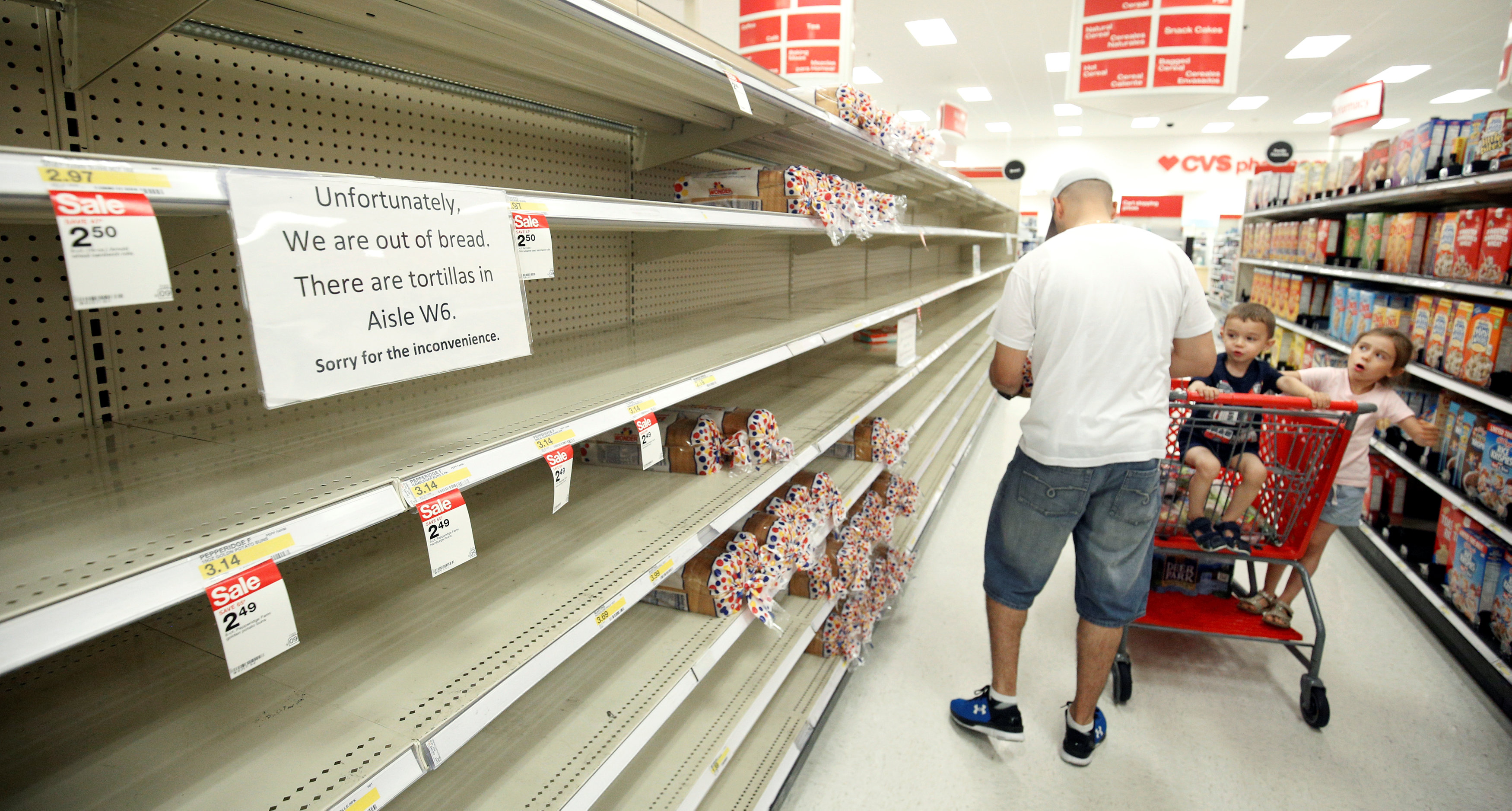 Shoppers encounter empty bread shelves ahead of the arrival of Hurricane Irma at a supermarket in Kissimmee, Florida, U.S. September 8, 2017. REUTERS/Gregg Newton
