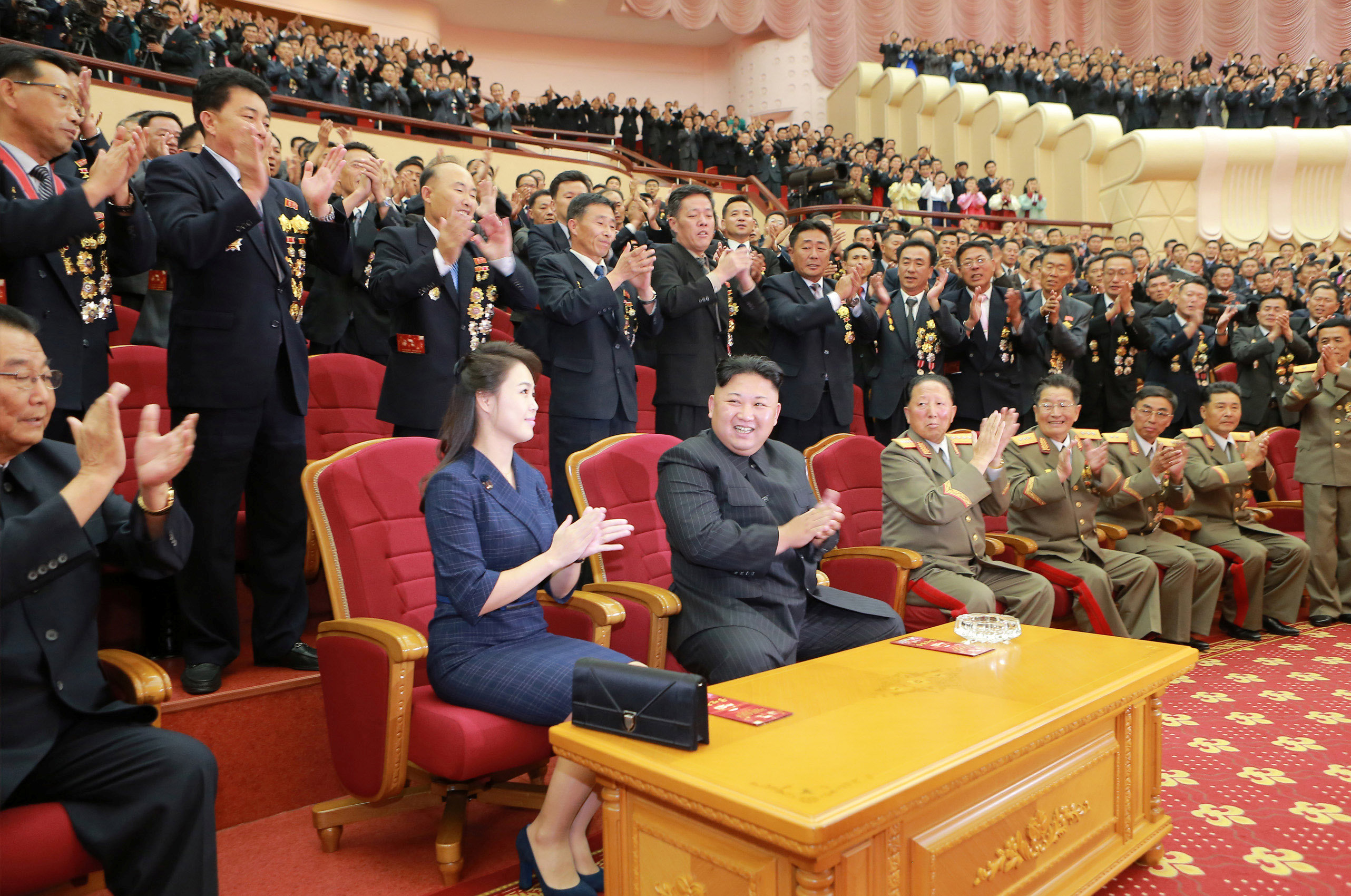 North Korean leader Kim Jong Un claps during a celebration for nuclear scientists and engineers who contributed to a hydrogen bomb test, in this undated photo released by North Korea's Korean Central News Agency (KCNA) in Pyongyang on September 10, 2017.