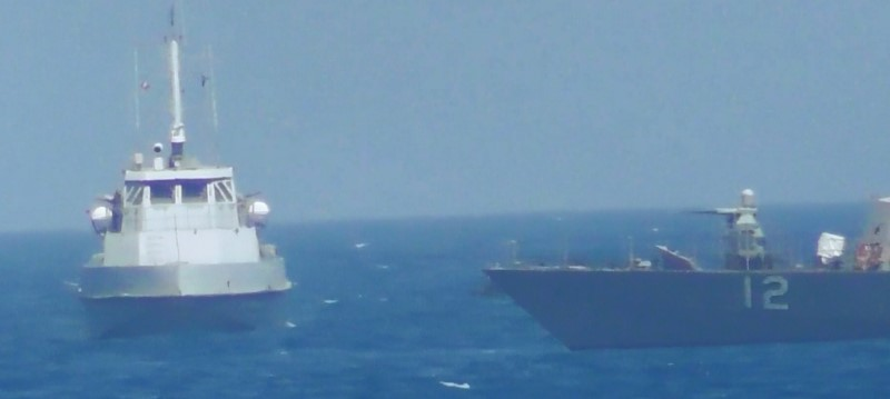 An Iranian vessel steers close to the U.S. Navy coastal patrol craft USS Thunderbolt (R) in the Gulf in a still image from video provided by the U.S. Navy July 25, 2017. U.S. Navy/Handout via REUTERS