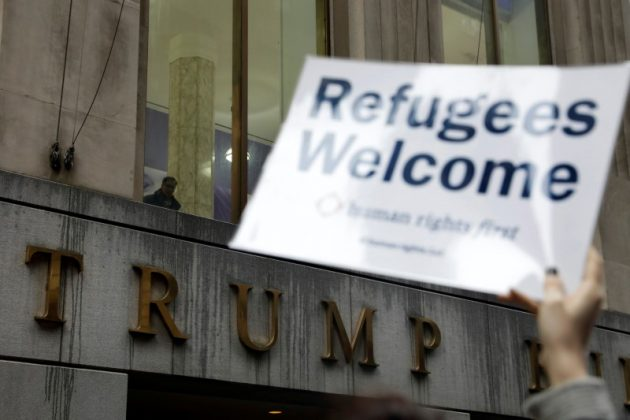 FILE PHOTO: Protesters gather outside the Trump Building at 40 Wall St. to take action against America's refugee ban in New York City, U.S., March 28, 2017. REUTERS/Lucas Jackson