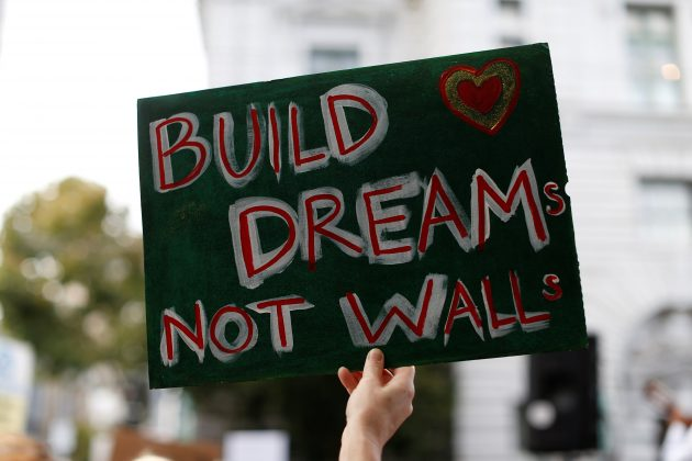 FILE PHOTO: A sign is seen during a rally against the rescindment of DACA (Deferred Action for Childhood Arrivals) program outside the San Francisco Federal Building in San Francisco, California, U.S., September 5, 2017. REUTERS/Stephen Lam