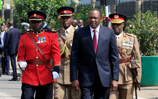 Kenya's President Uhuru Kenyatta walks to inspect the honour guard before the opening of the 12th Parliament outside the National Assembly Chamber in Nairobi, Kenya September 12, 2017. REUTERS/Thomas Mukoya