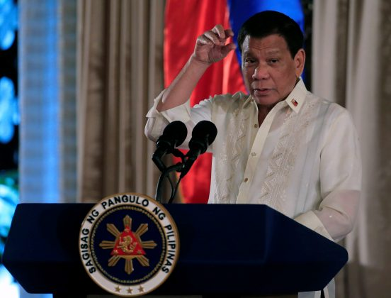 FILE PHOTO: Philippine President Rodrigo Duterte gestures as he delivers his speech, during the oath taking of Philippine National Police (PNP) star rank officers, at the Malacanang Presidential Palace in Manila, Philippines August 30, 2017. REUTERS/Romeo Ranoco