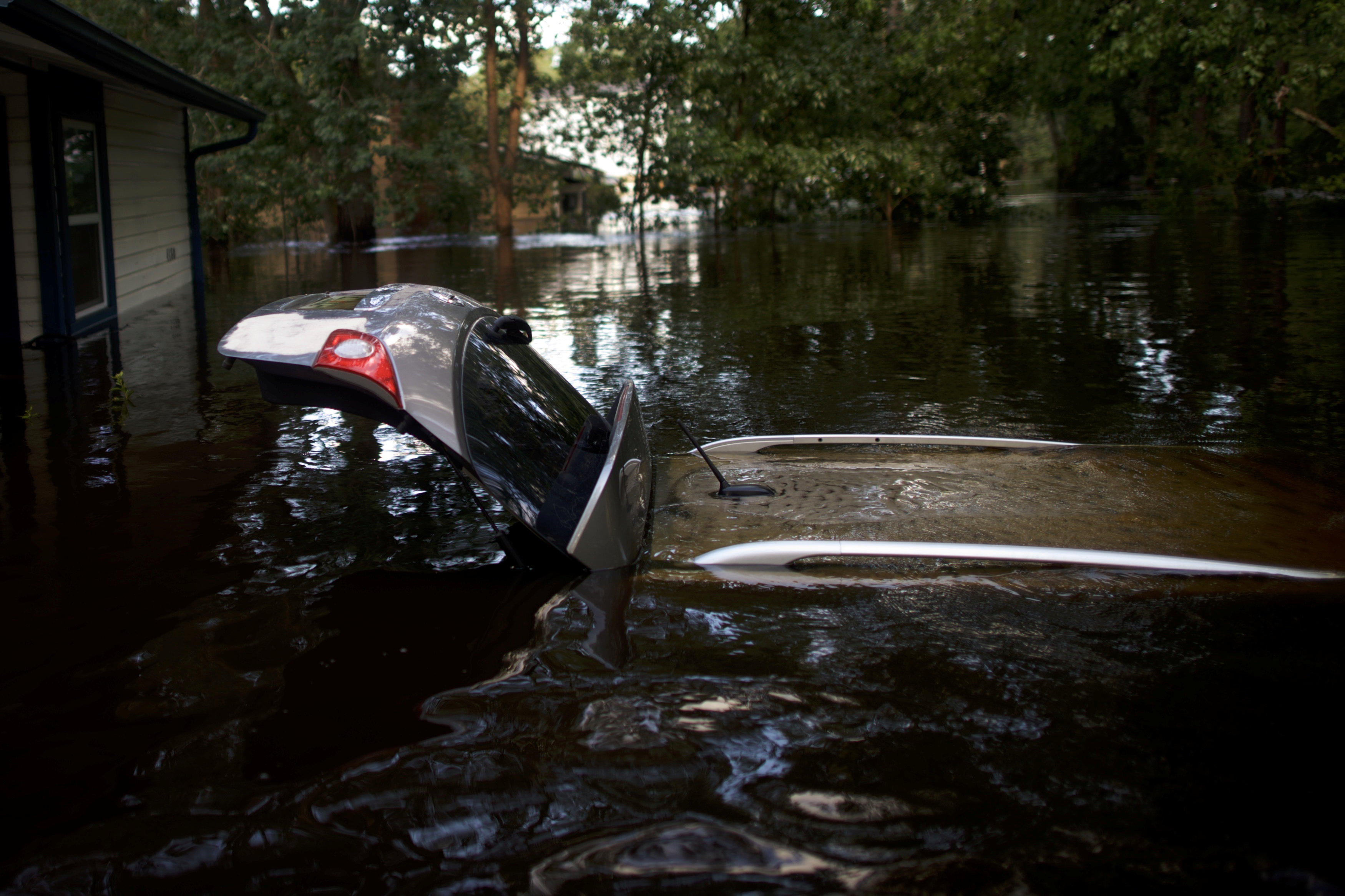 Flood waters engulf a car after Hurricane Irma in Jacksonville, Florida, U.S. September 12, 2017. REUTERS/Mark Makela