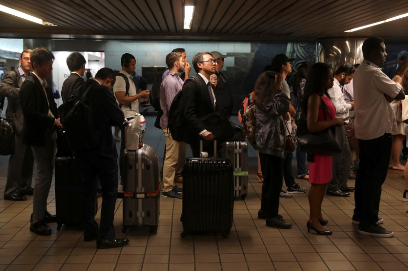 People wait in line to purchase New York subway MetroCards at Pennsylvania Station in New York City, U.S., June 12, 2017. REUTERS/Shannon Stapleton
