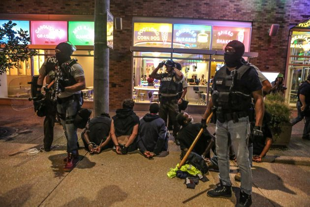 Police detain protesters arrested for causing damage to local businesses during the second night of demonstrations after a not guilty verdict in the murder trial of former St. Louis police officer Jason Stockley, charged with the 2011 shooting of Anthony Lamar Smith, who was black, in St. Louis, Missouri, U.S., September 16, 2017.