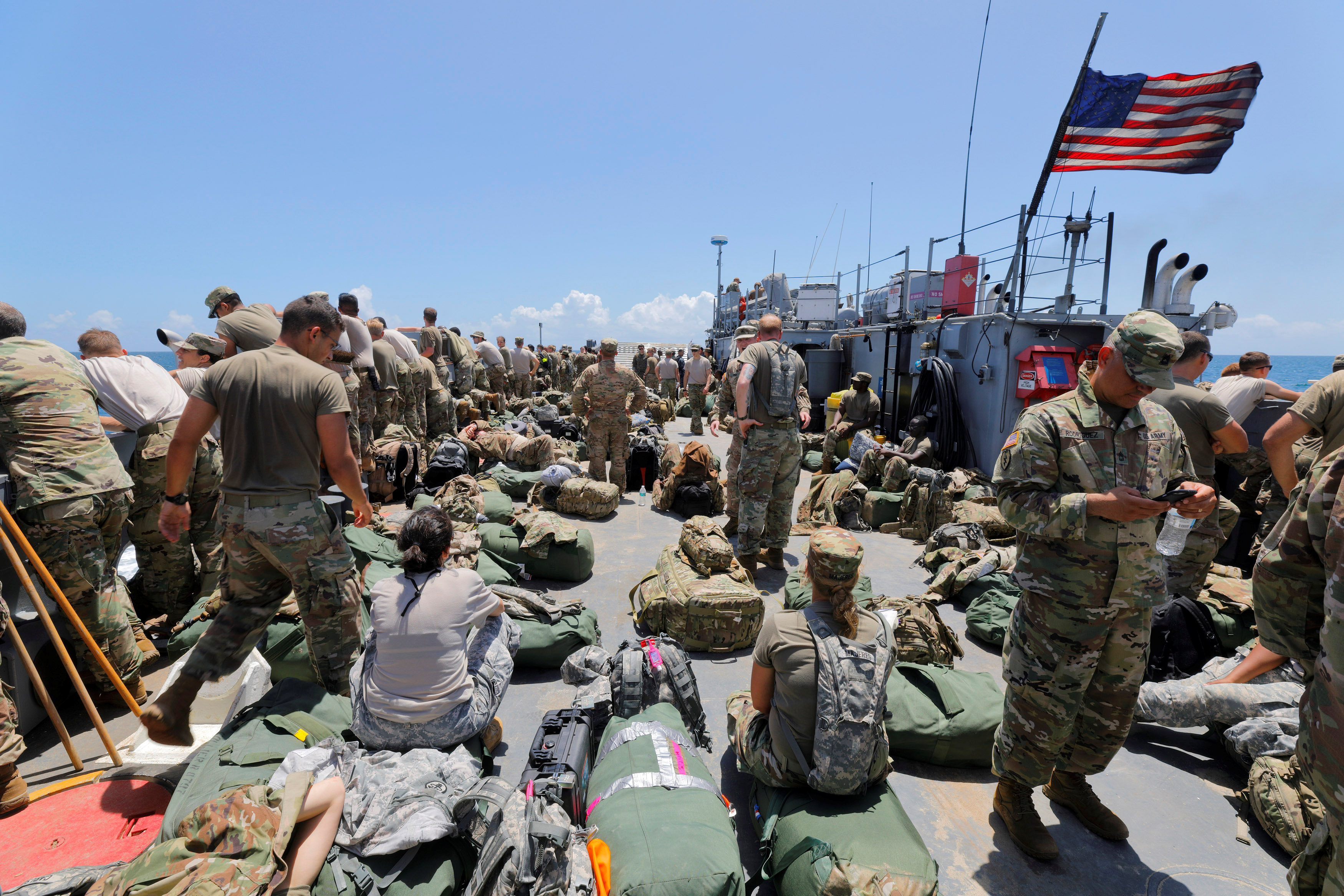The deck of a U.S. Navy landing craft is crowded with Army soldiers and their belongings as they are evacuated in advance of Hurricane Maria, off St. Thomas shore, U.S. Virgin Islands September 17, 2017. REUTERS/Jonathan Drake