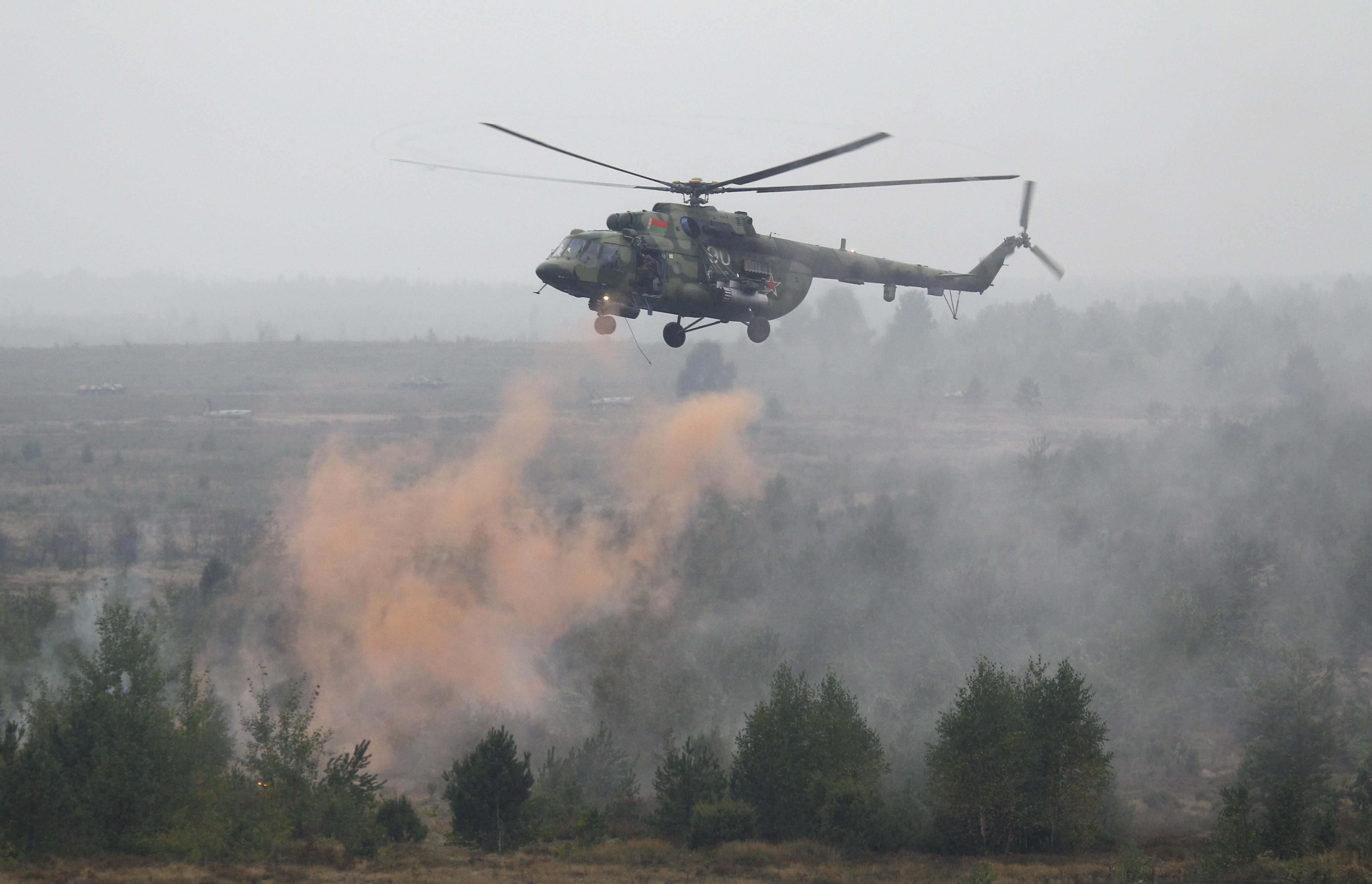 A Belarussian Mi-8 helicopter flies above a firing range during the Zapad-2017 war games, held by Russian and Belarussian servicemen, outside the town of Ruzhany in Belarus, September 17, 2017.
