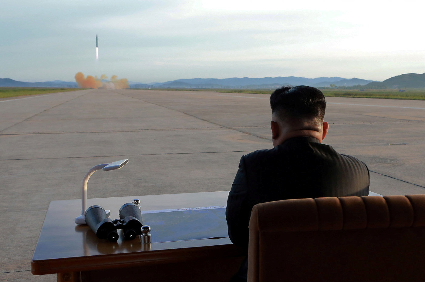 North Korean leader Kim Jong Un watches the launch of a Hwasong-12 missile in this undated photo released by North Korea's Korean Central News Agency (KCNA) on September 16, 2017. KCNA via REUTERS