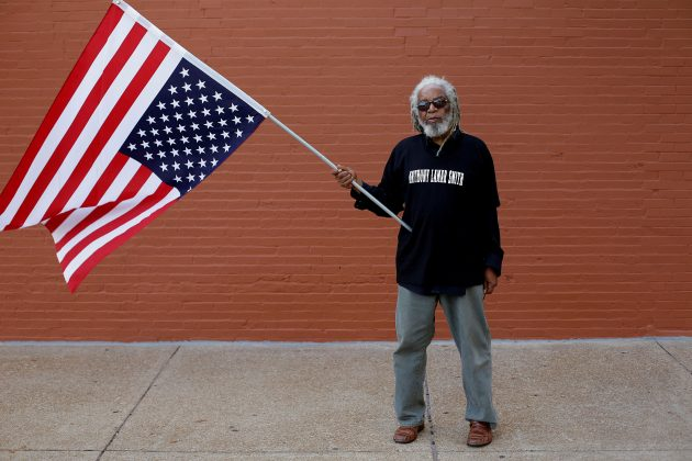 FILE PHOTO: Bill Monroe poses for a portrait as he protests the not guilty verdict in the murder trial of Jason Stockley, a former St. Louis police officer charged with the 2011 shooting of Anthony Lamar Smith, in St. Louis, Missouri, U.S., September 17, 2017. REUTERS/Joshua Lott/File Photo