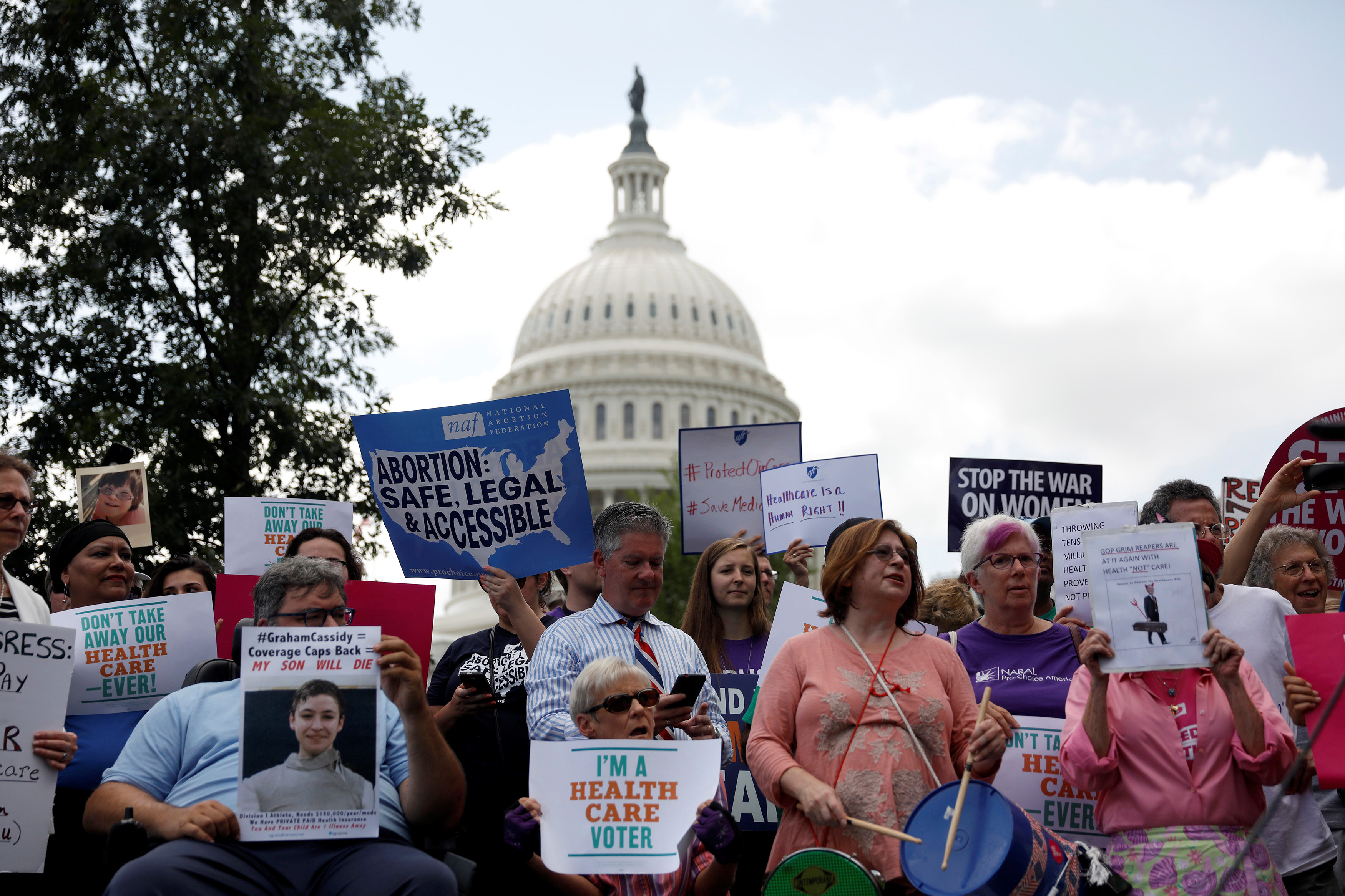 Activists participate in a rally to protect the Affordable Care Act outside the U.S. Capitol in Washington, U.S., September 19, 2017. REUTERS/Aaron P. Bernstein