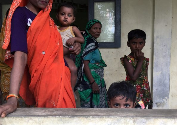 FILE PHOTO: A Hindu family is seen at a shelter near Maungdaw, Rakhine state, Myanmar September 12, 2017. REUTERS/Stringer/File Photo