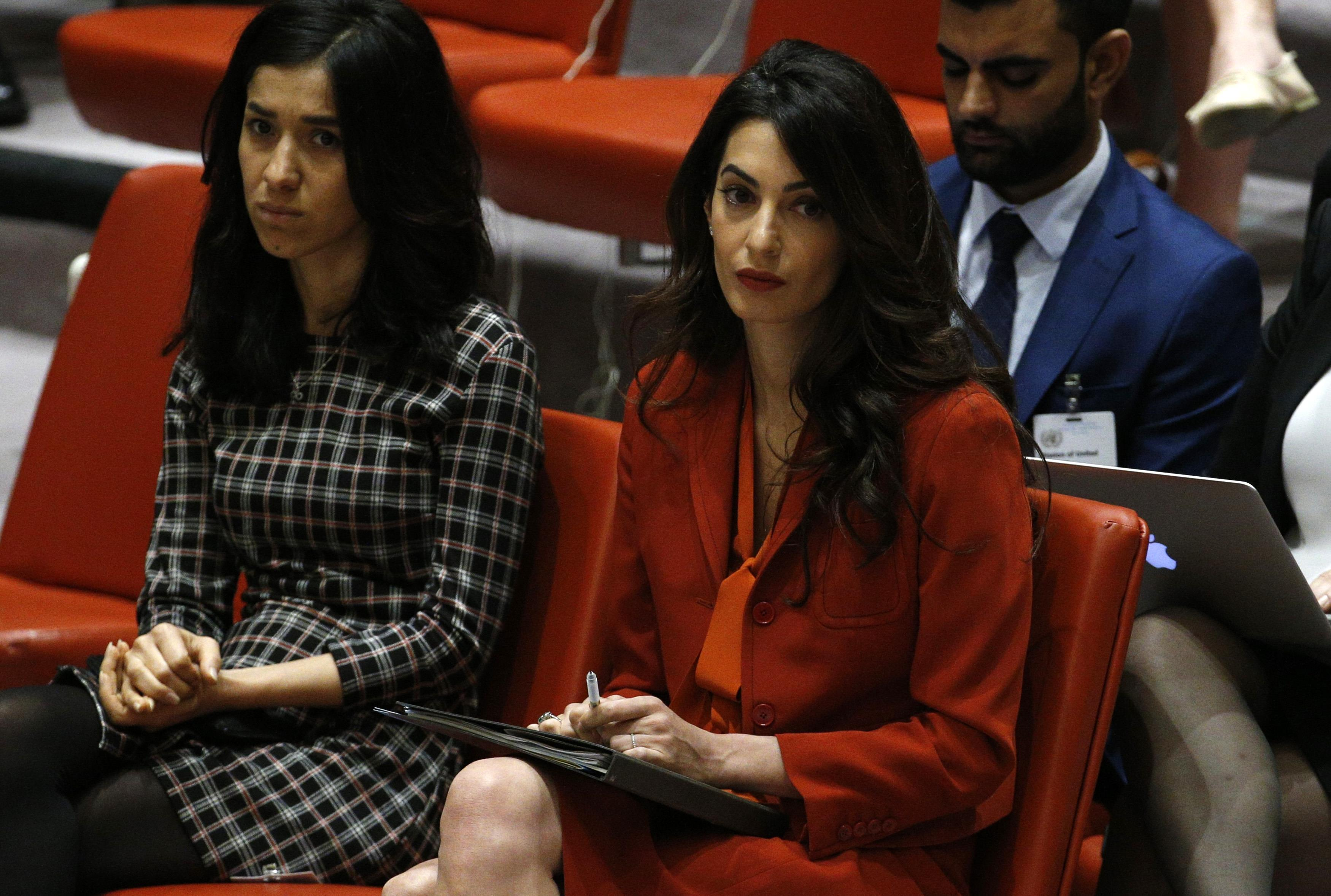 Activist Amal Clooney (R) attends a United Nations Security Council meeting set to adopt a resolution to help preserve evidence of Islamic State crimes in Iraq, during the 72nd United Nations General Assembly at U.N. Headquarters in New York, U.S., September 21, 2017. REUTERS/Brendan