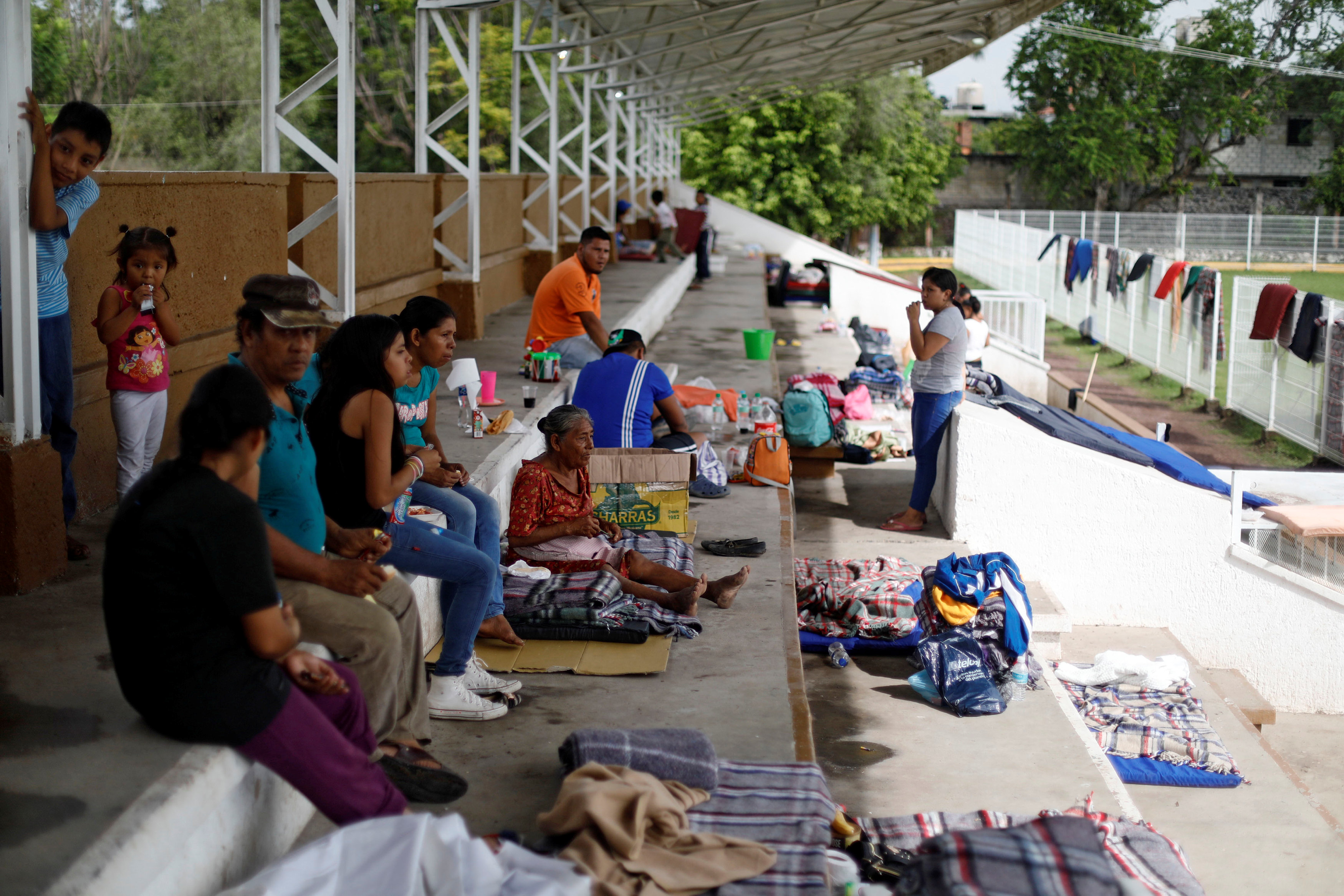 People sit in the bleachers of a stadium at a shelter set up by the army after an earthquake, in Jojutla de Juarez, Mexico September 21, 2017. REUTERS/Edgard Garrido