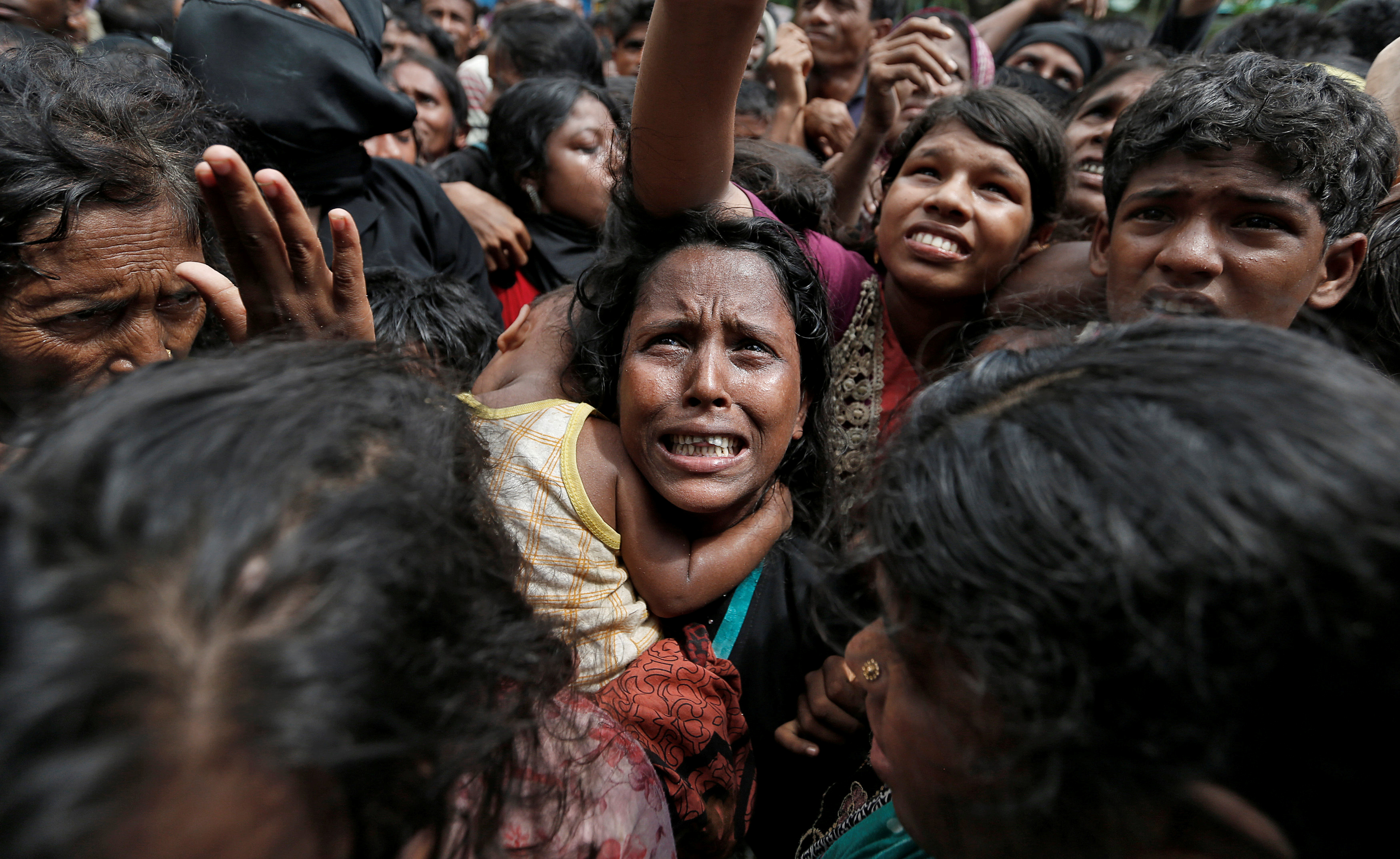 A woman reacts as Rohingya refugees wait to receive aid in Cox's Bazar, Bangladesh, September 21, 2017. REUTERS/Cathal McNaughton