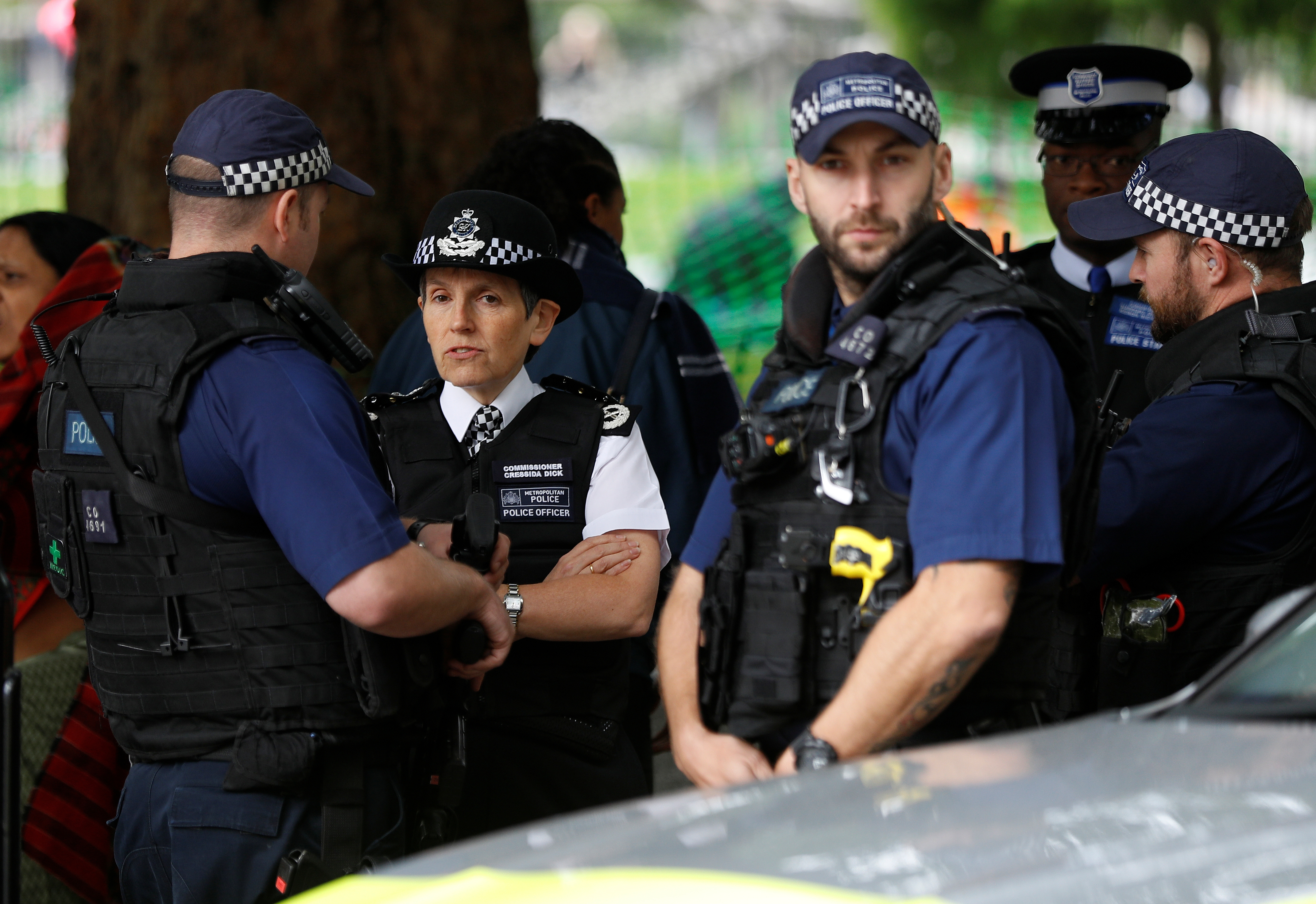 Cressida Dick, the Metropolitan Police Commissioner chats to armed officers as she walks along the Southbank in London, Britain, September 16, 2017. REUTERS/Peter Nicholls
