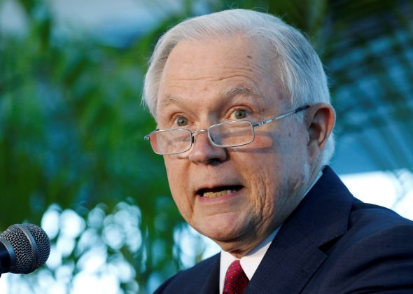 FILE PHOTO: U.S. Attorney General Jeff Sessions speaks on the growing trend of violent crime in sanctuary cities during an event on the Port of Miami in Miami, Florida, U.S. on, August 16, 2017. REUTERS/Joe Skipper/File Photo
