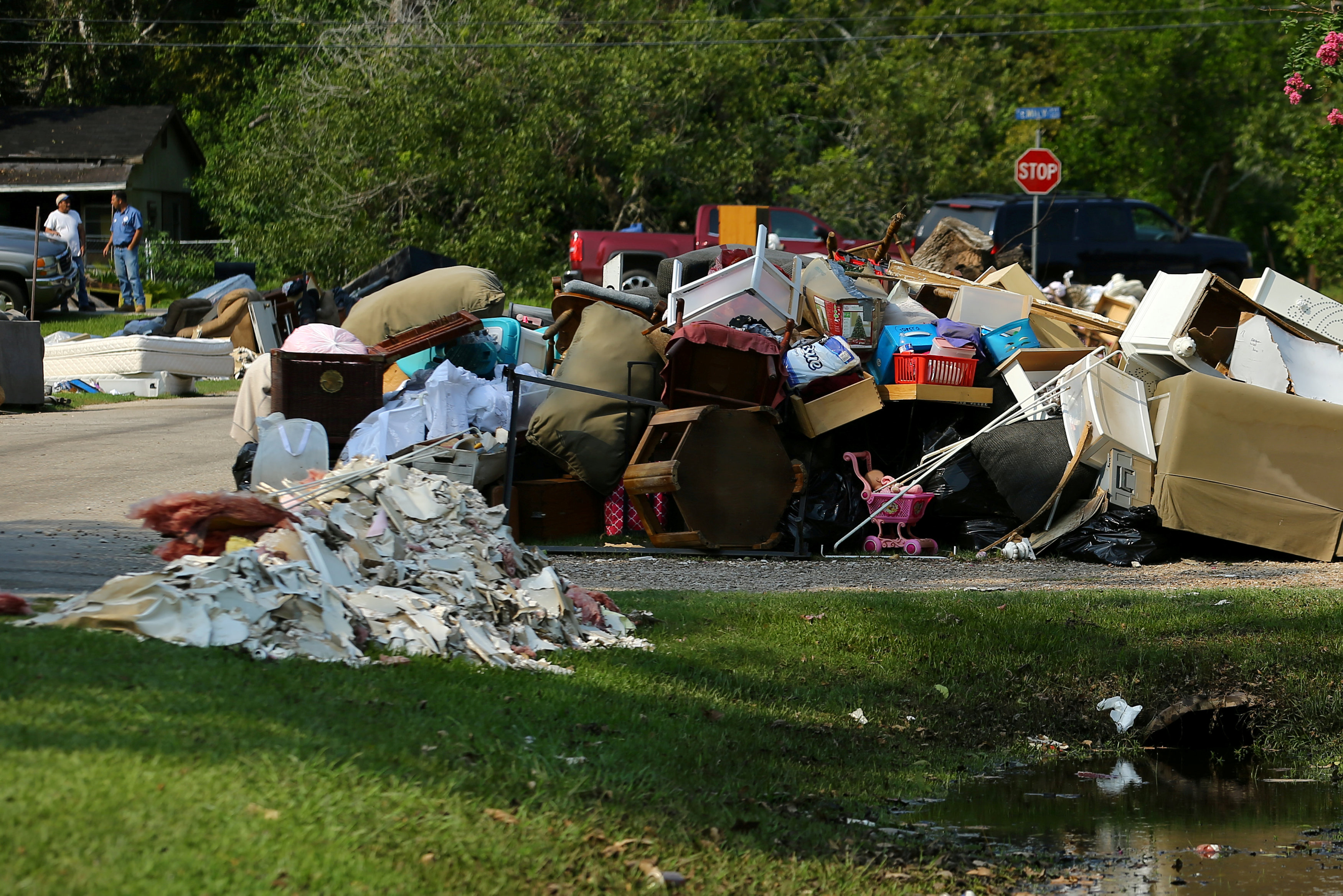 FILE PHOTO: Flood-damaged contents from people's homes line the street following the aftermath of tropical storm Harvey in Wharton, Texas, U.S., September 6, 2017. REUTERS/Mike Blake/File Photo