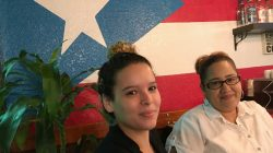 Evelyn Carrillo, 24, (L) and Deserie Rivera, 34, pose for a photo at Café Borinquen, the Puerto Rican restaurant where they work in Plantation, Florida, U.S., September 21, 2017. Photo taken September 21, 2017. REUTERS/Bernie Woodall