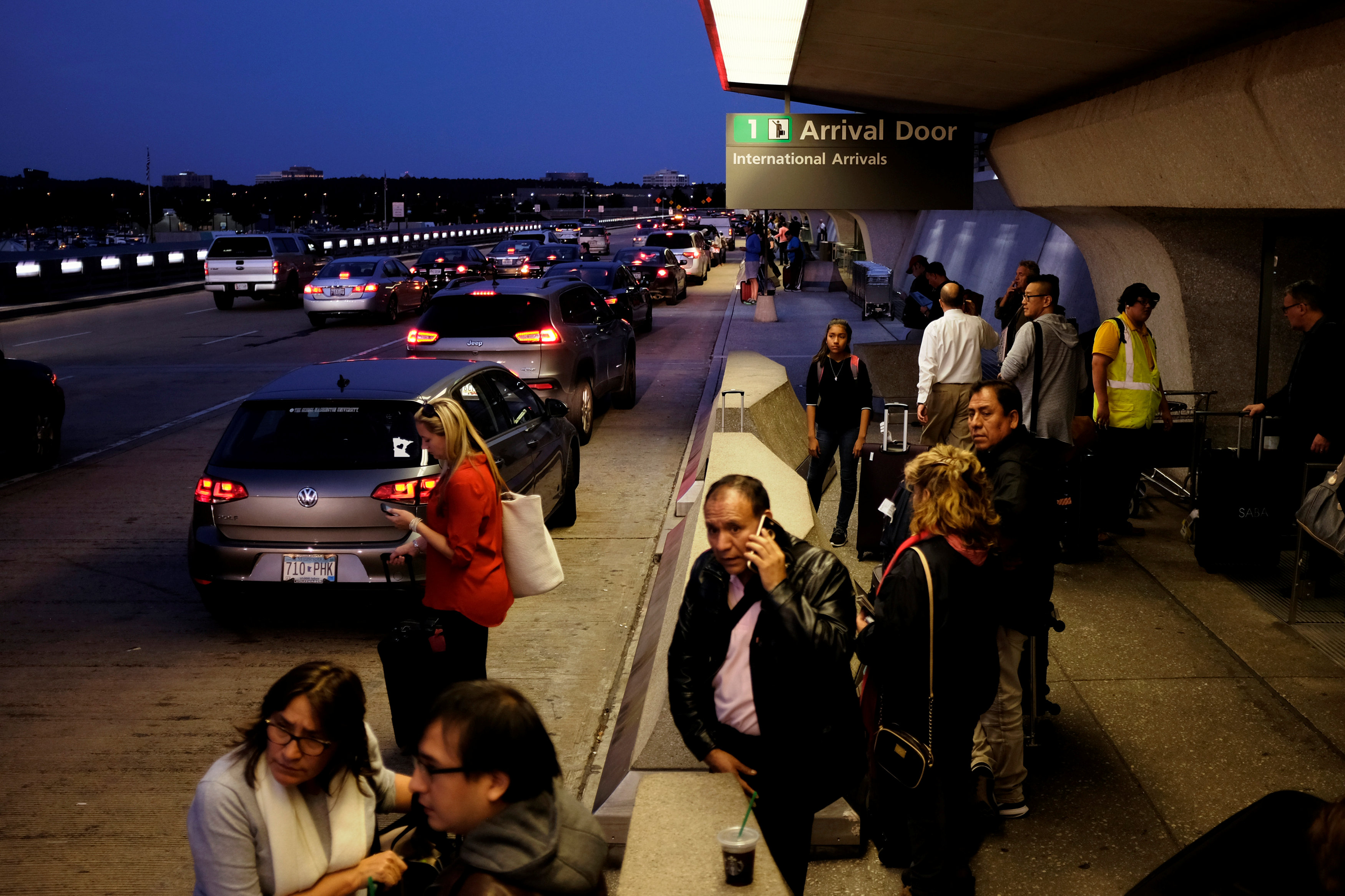International passengers wait for their rides outside the international arrivals exit at Washington Dulles International Airport in Dulles, Virginia, U.S. September 24, 2017.