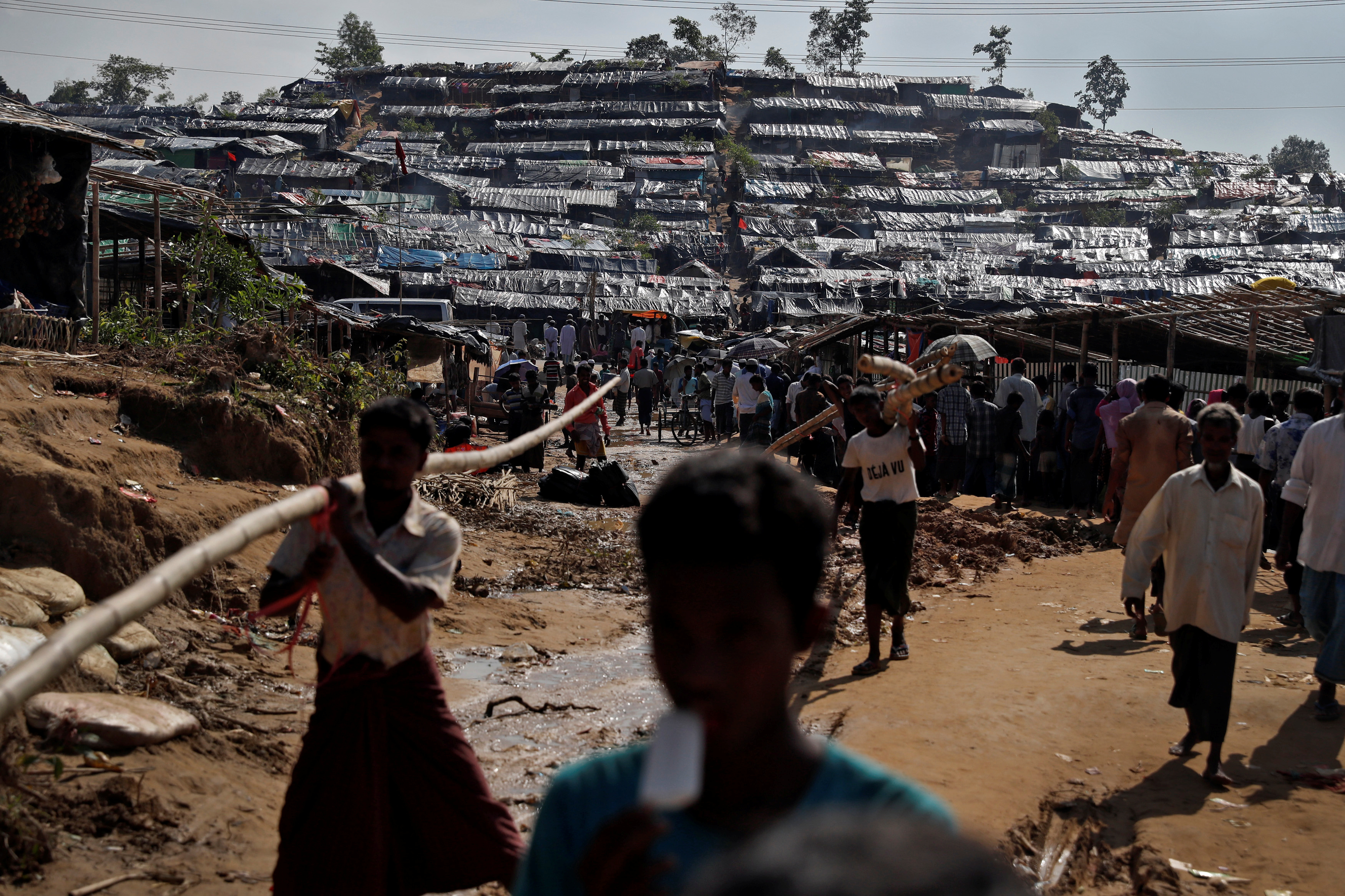 Rohingya refugees walk through a camp in Cox's Bazar, Bangladesh, September 25, 2017. REUTERS/Cathal McNaughton