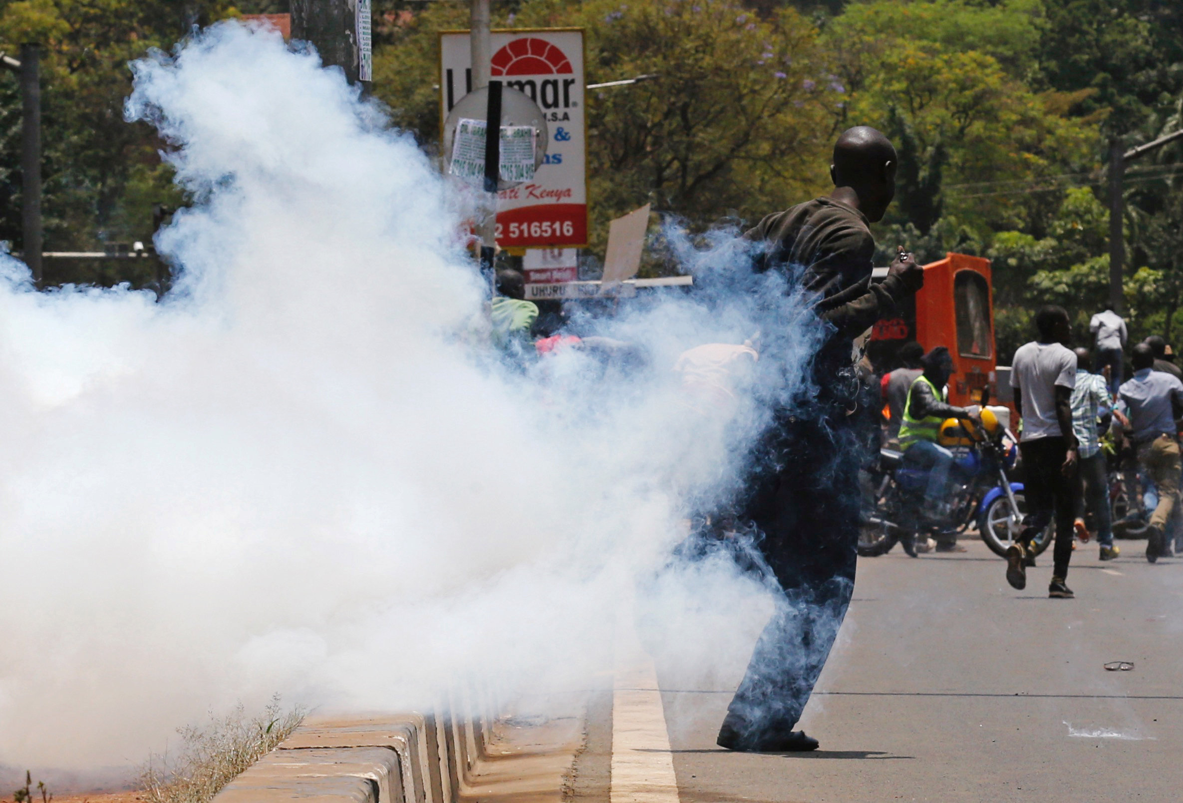 A supporter of the opposition National Super Alliance (NASA) coalition runs after riot policemen dispersed protesters during a demonstration calling for the removal of Independent Electoral and Boundaries Commission (IEBC) officials in Nairobi, Kenya September 26, 2017. REUTERS/Thomas Mukoya
