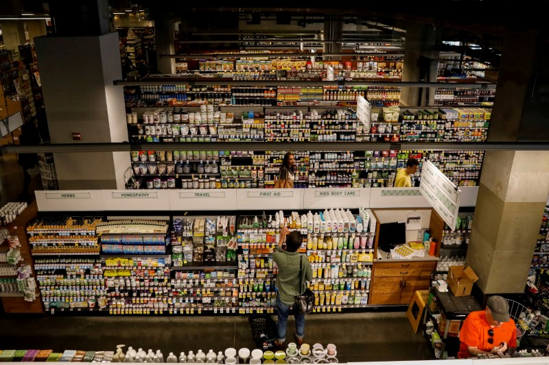 FILE PHOTO: Customers shop at a Whole Foods store in New York City, U.S., August 28, 2017. REUTERS/Brendan McDermid/File Photo